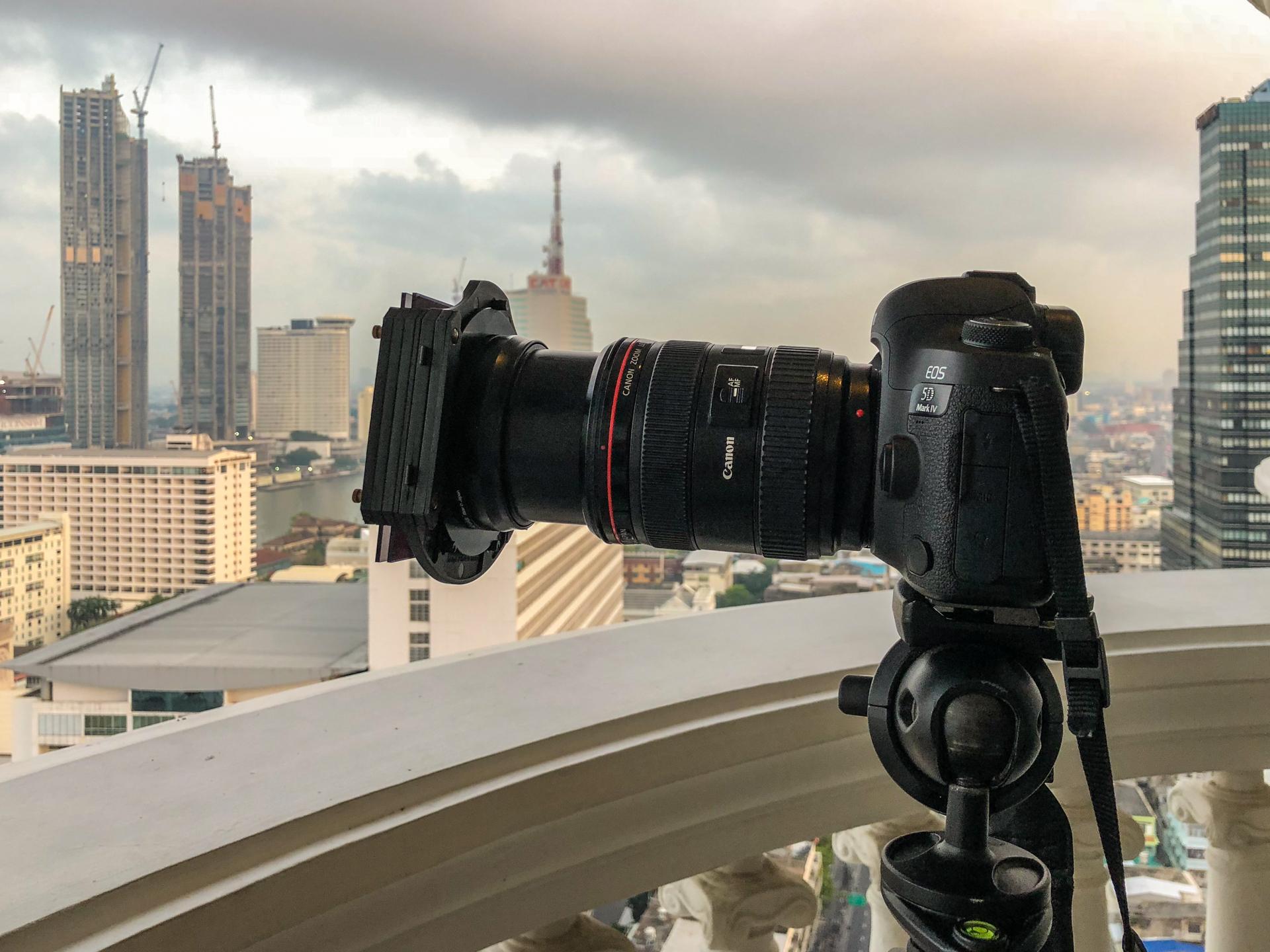Photographing theBangkok skyline from a hotel balcony.
