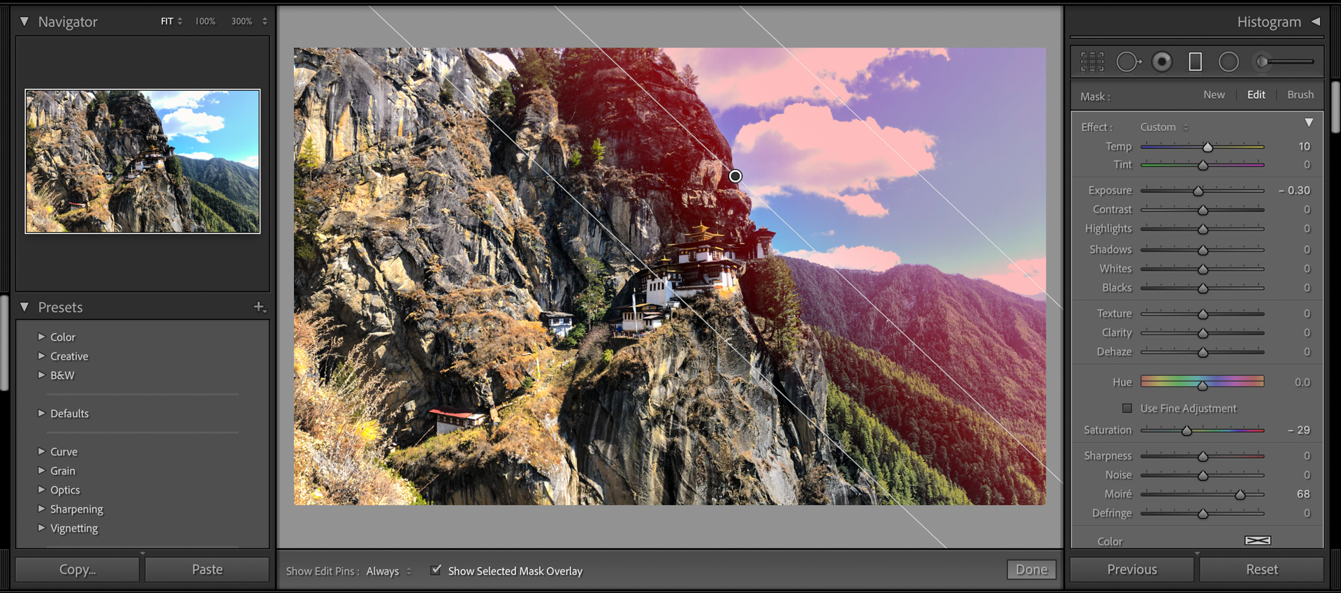 A linear gradient being applied in Lightroom over the sky section of the image