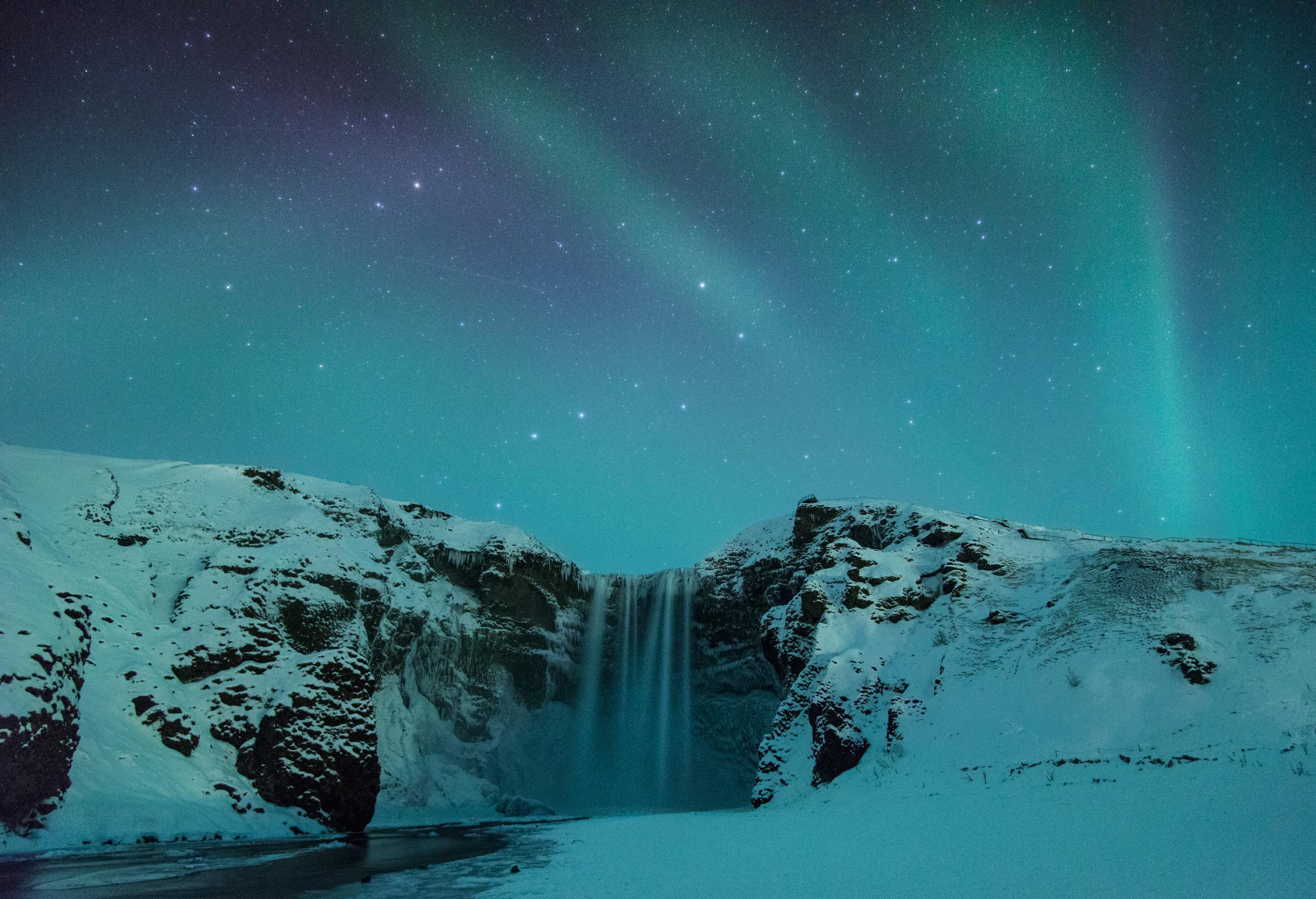 The Aurora over Skogafoss, Iceland