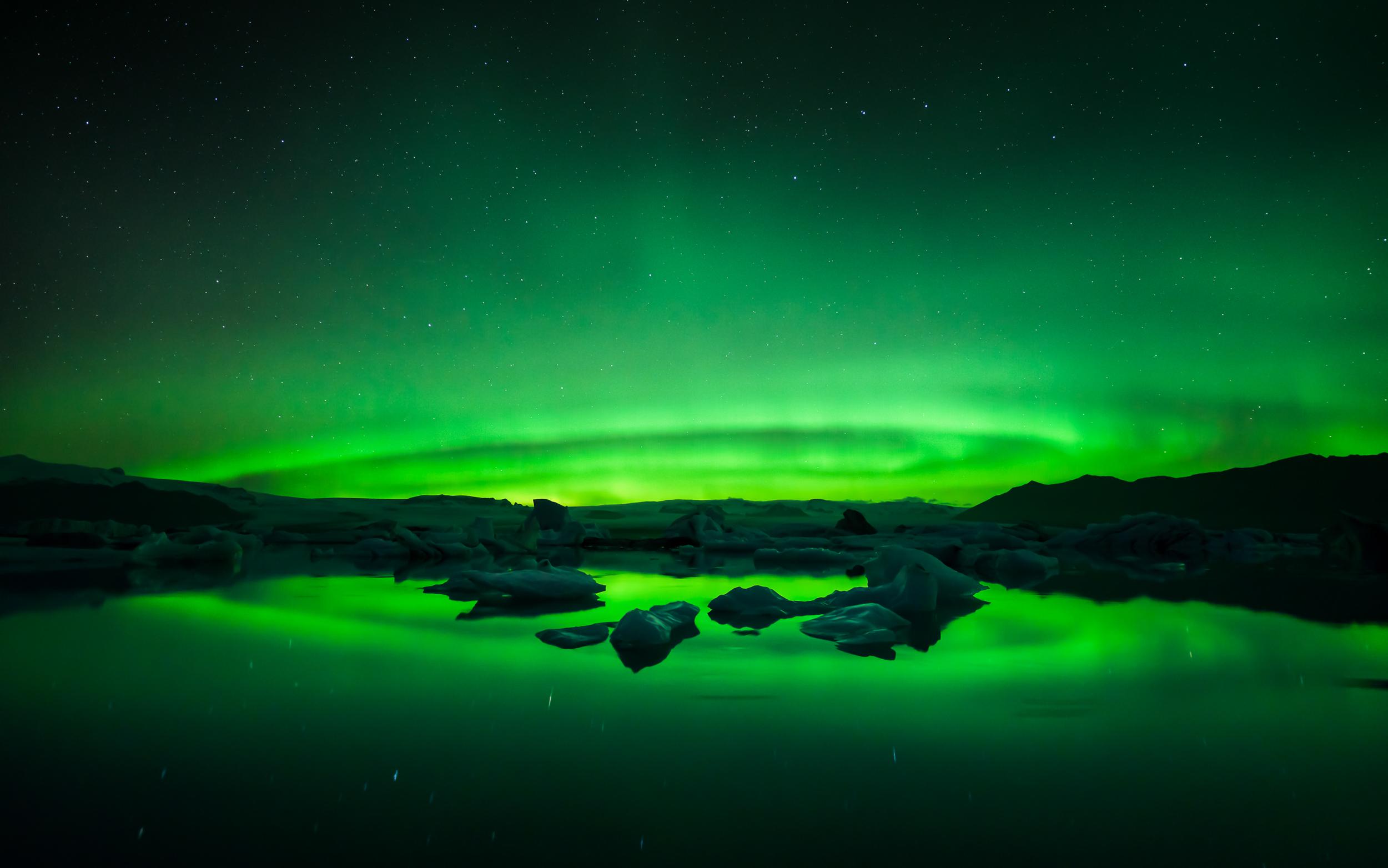 A fantastic active Aurora (Northern Lights) over the Jökulsárlón Glacier Lagoon in Iceland