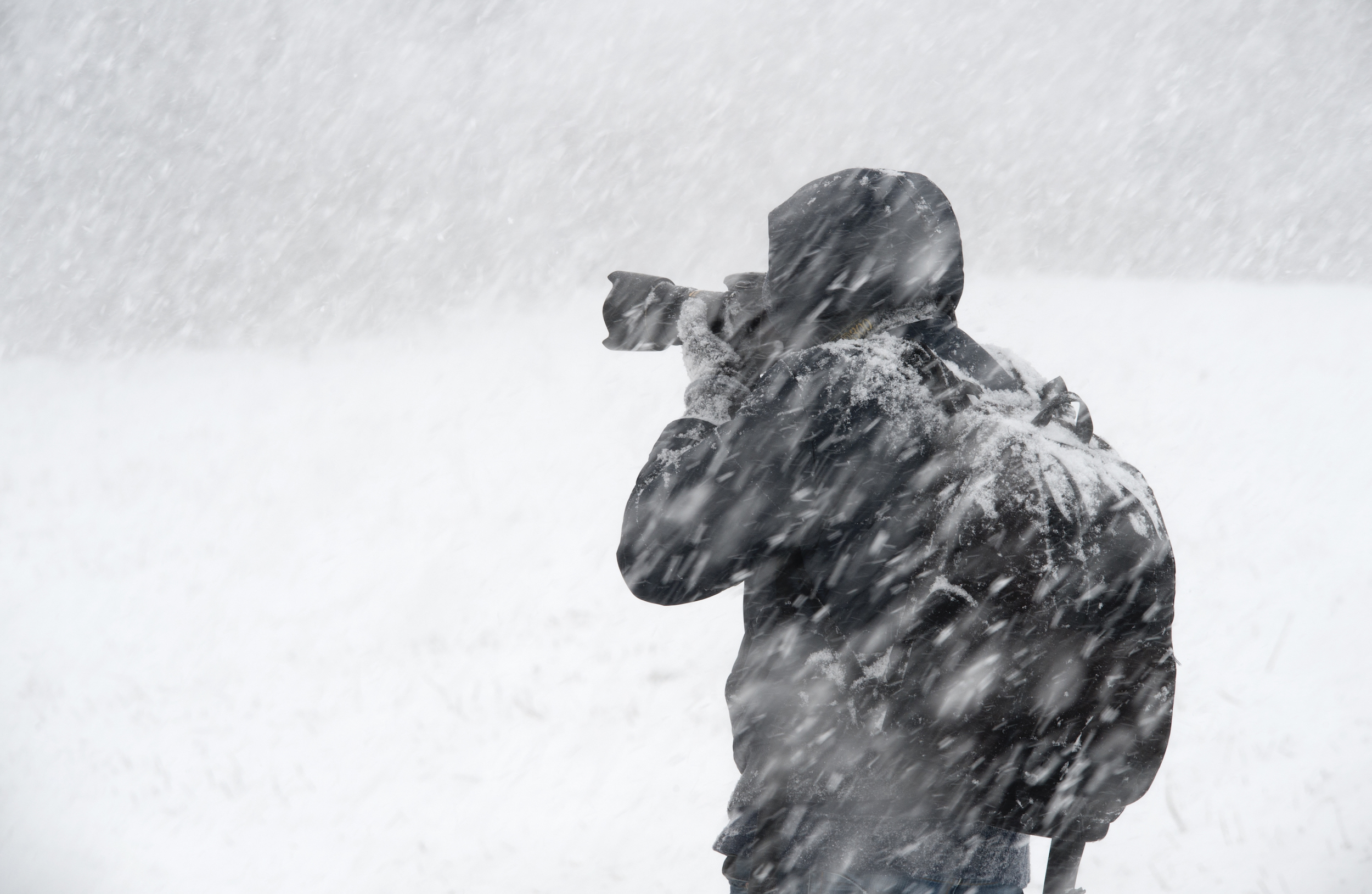 Photographer taking pictures in snowy conditions