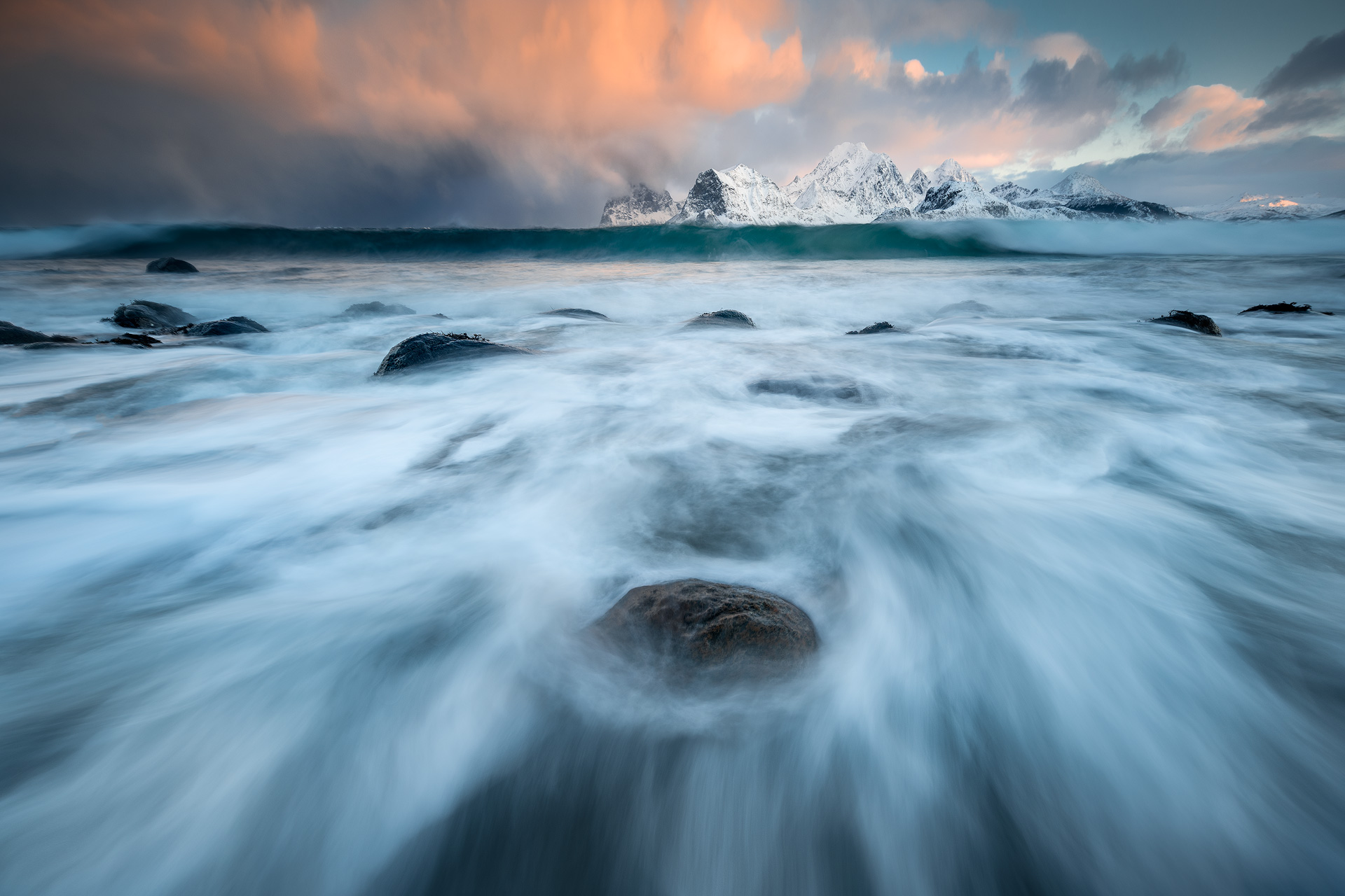 Wintry seascape from a low-down perspective with crashing waves