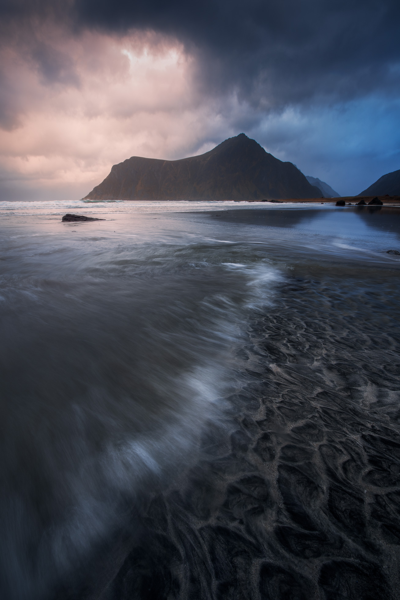 Seascape at Lofoten with waves in the foreground