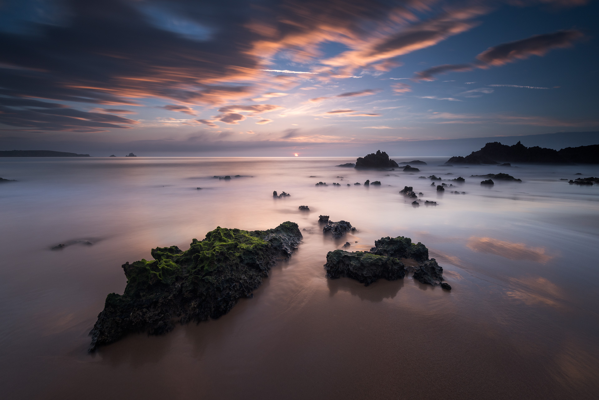 Seascape with rocks in the foreground