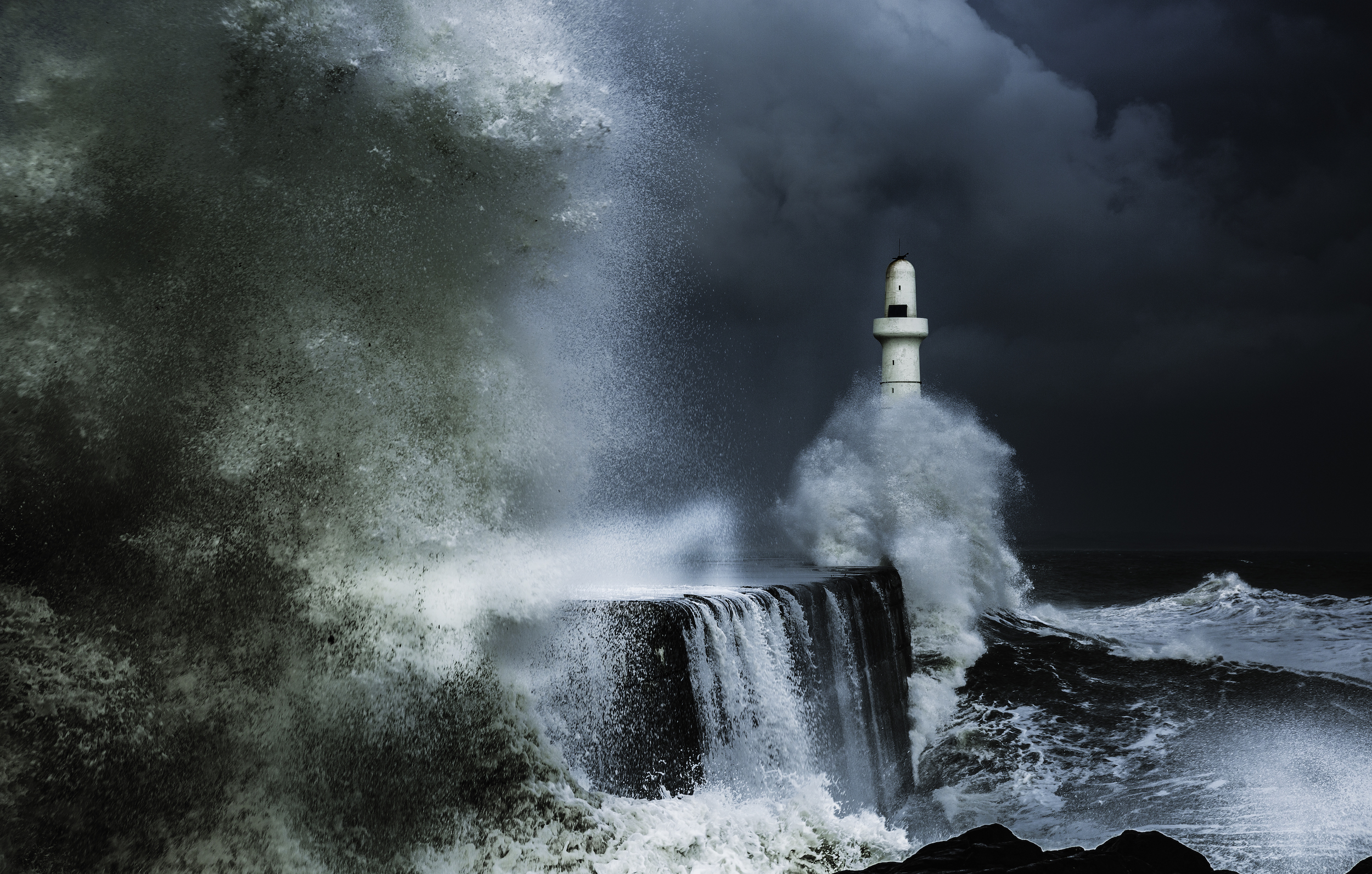 Waves crashing against a breakwater in stormy conditions