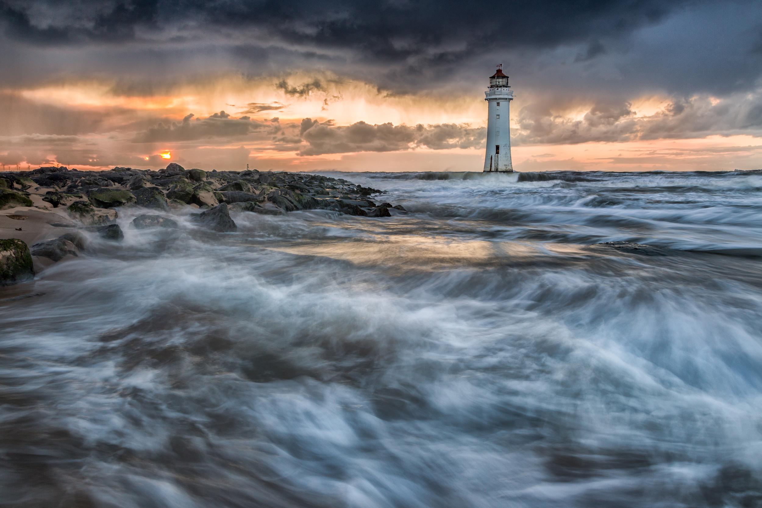 Waves crashing against the shore at New Brighton, England