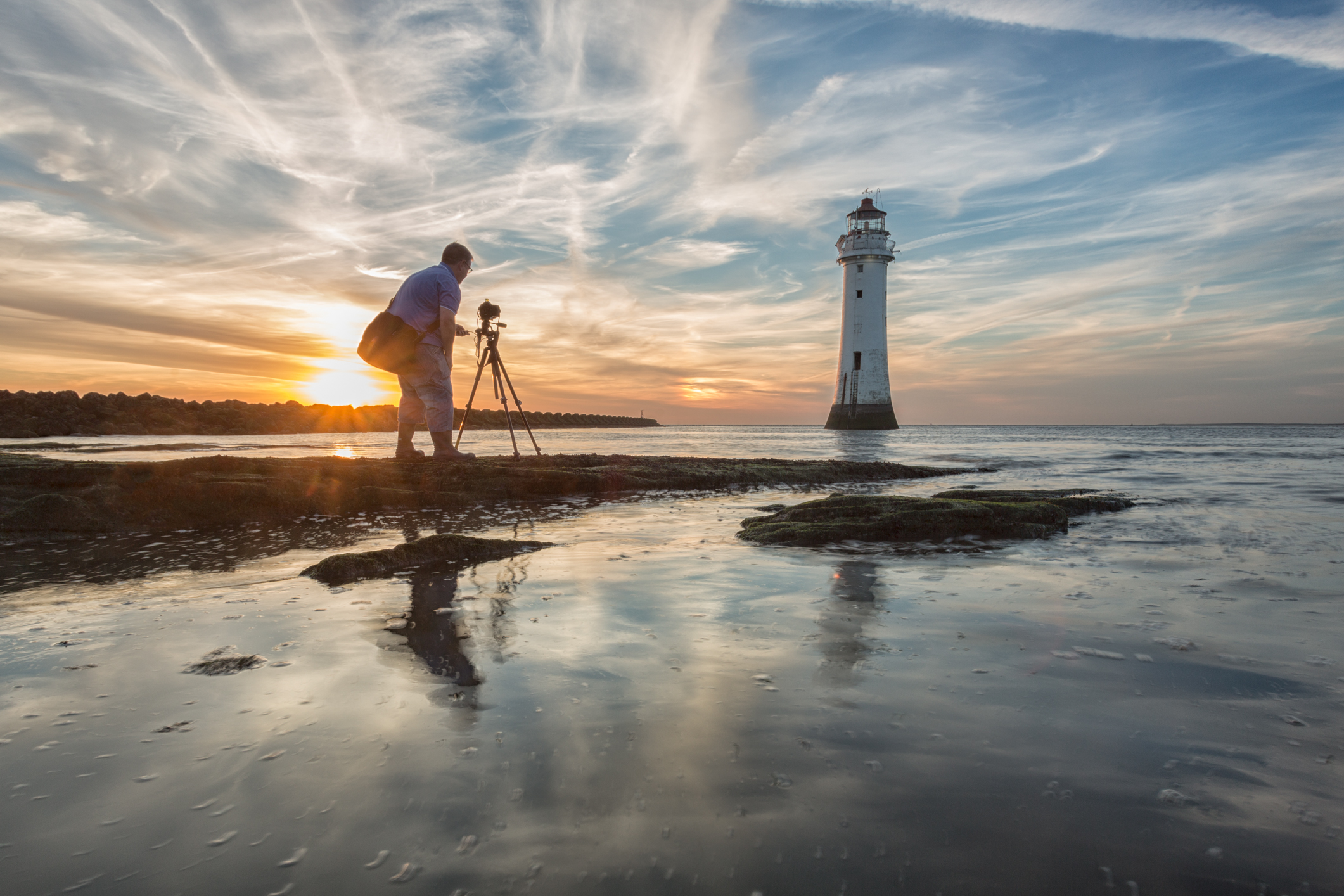 Photographer getting prepared to photograph New Brighton Lighthouse, England