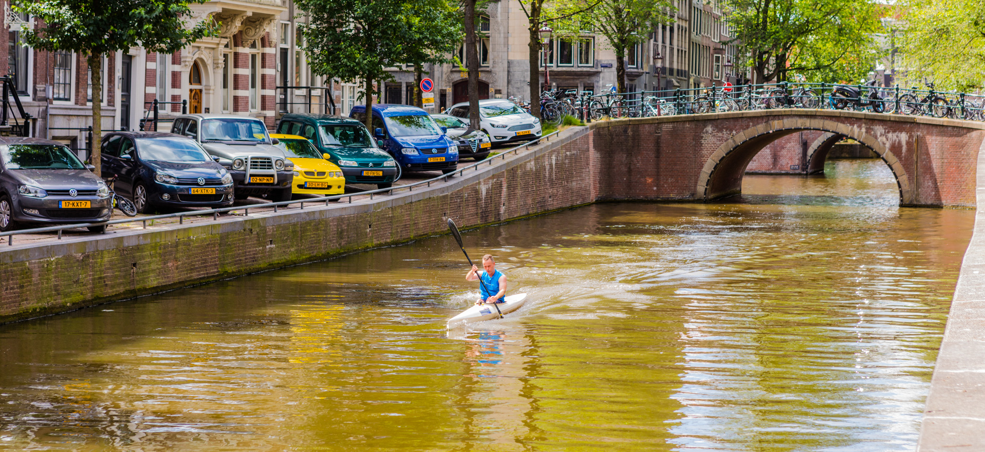 A kayaker on a canal in Amsterdam