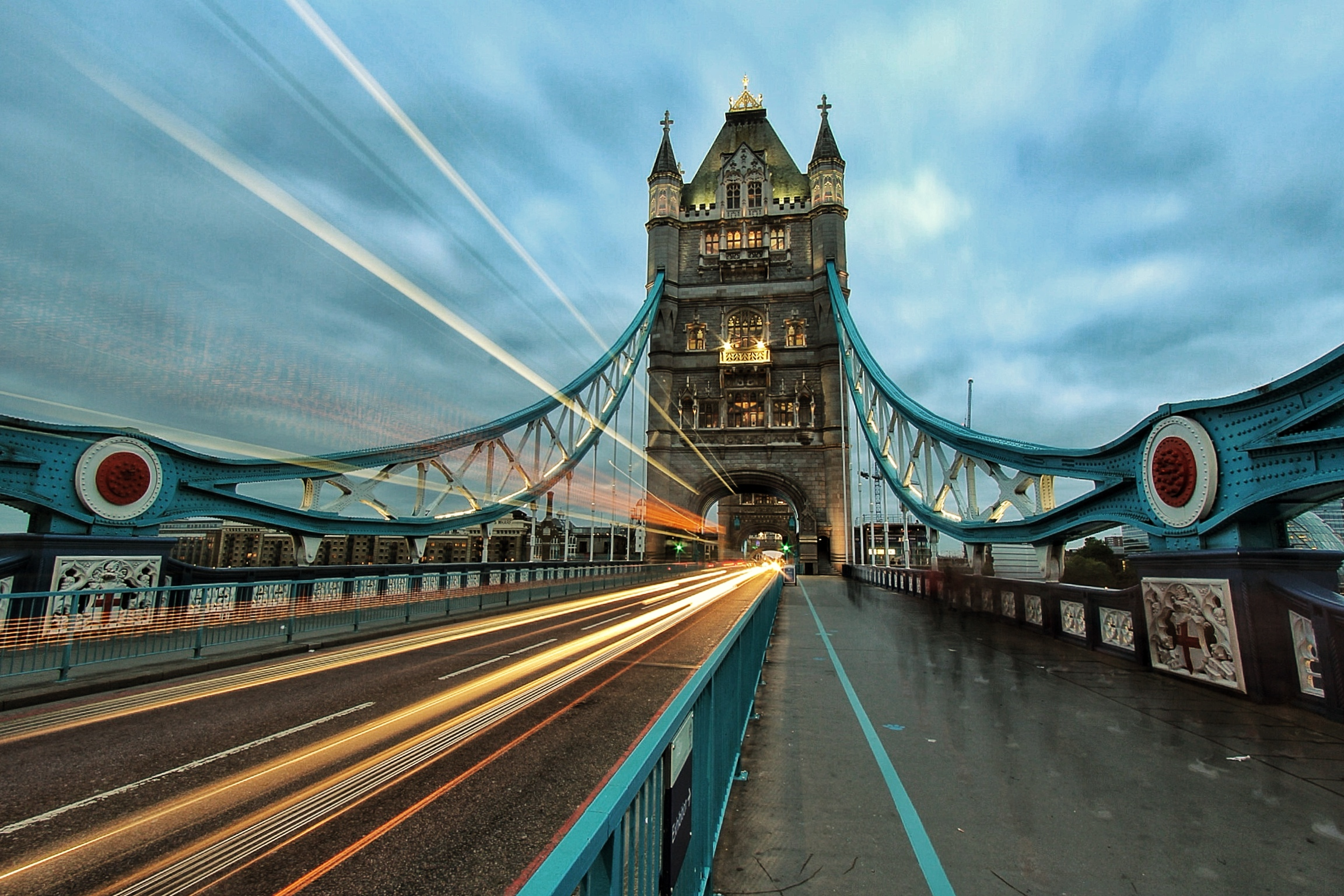 Motion blur from traffic passing through the arches of Tower Bridge, over the River Thames, London.