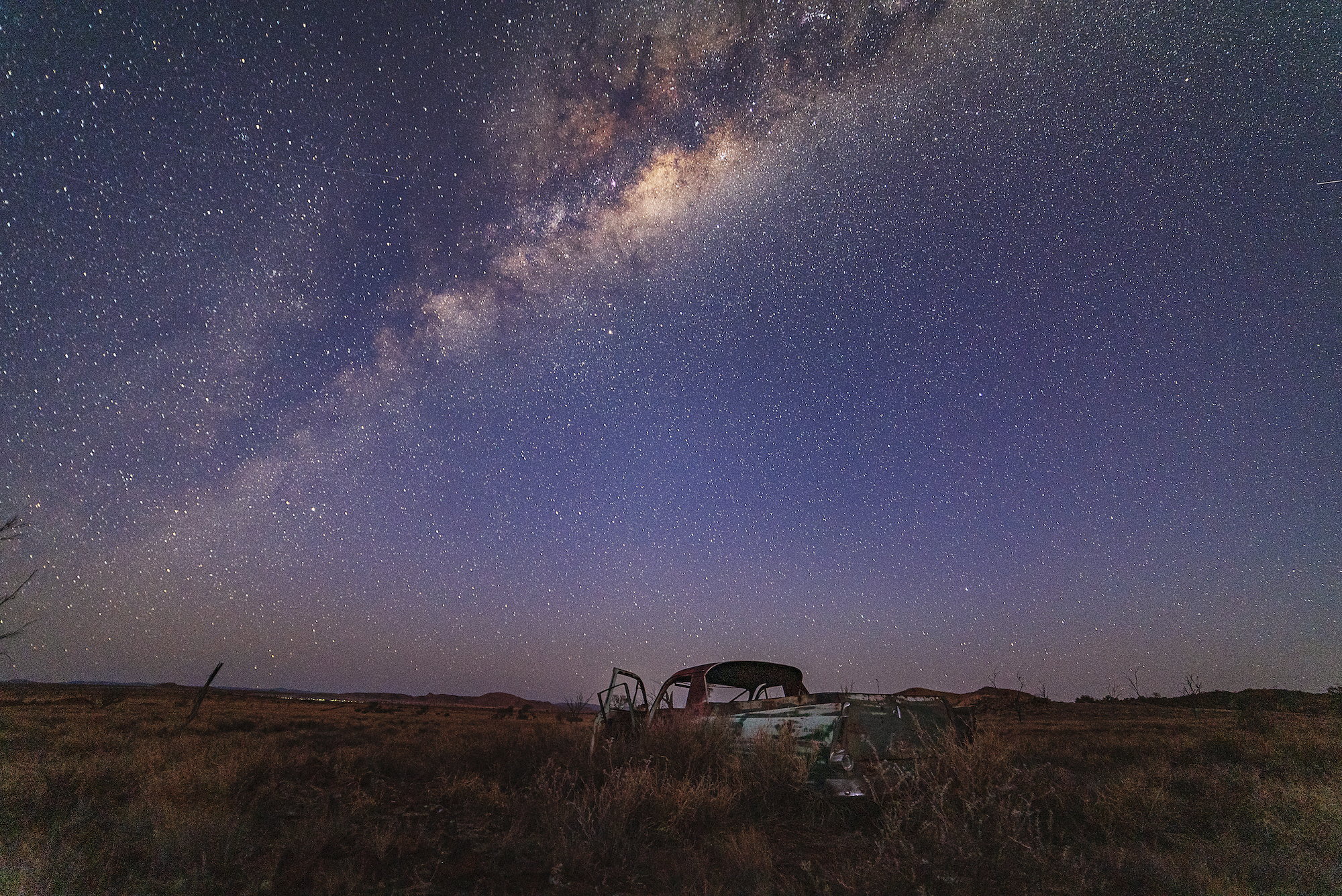 An abandoned old Ute under the Milky Way, remote Western Australia.