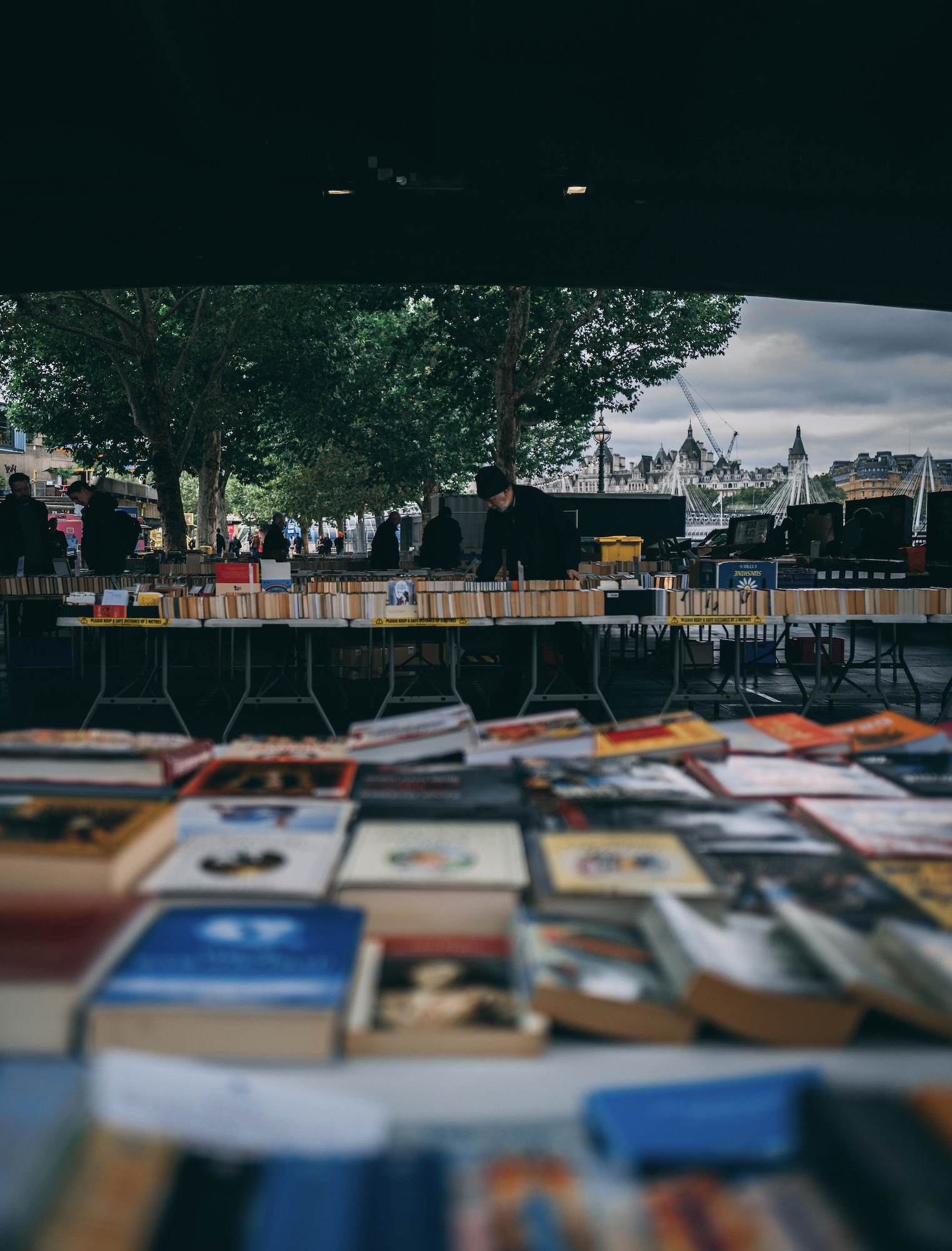 Browsing through books on the South Bank, London
