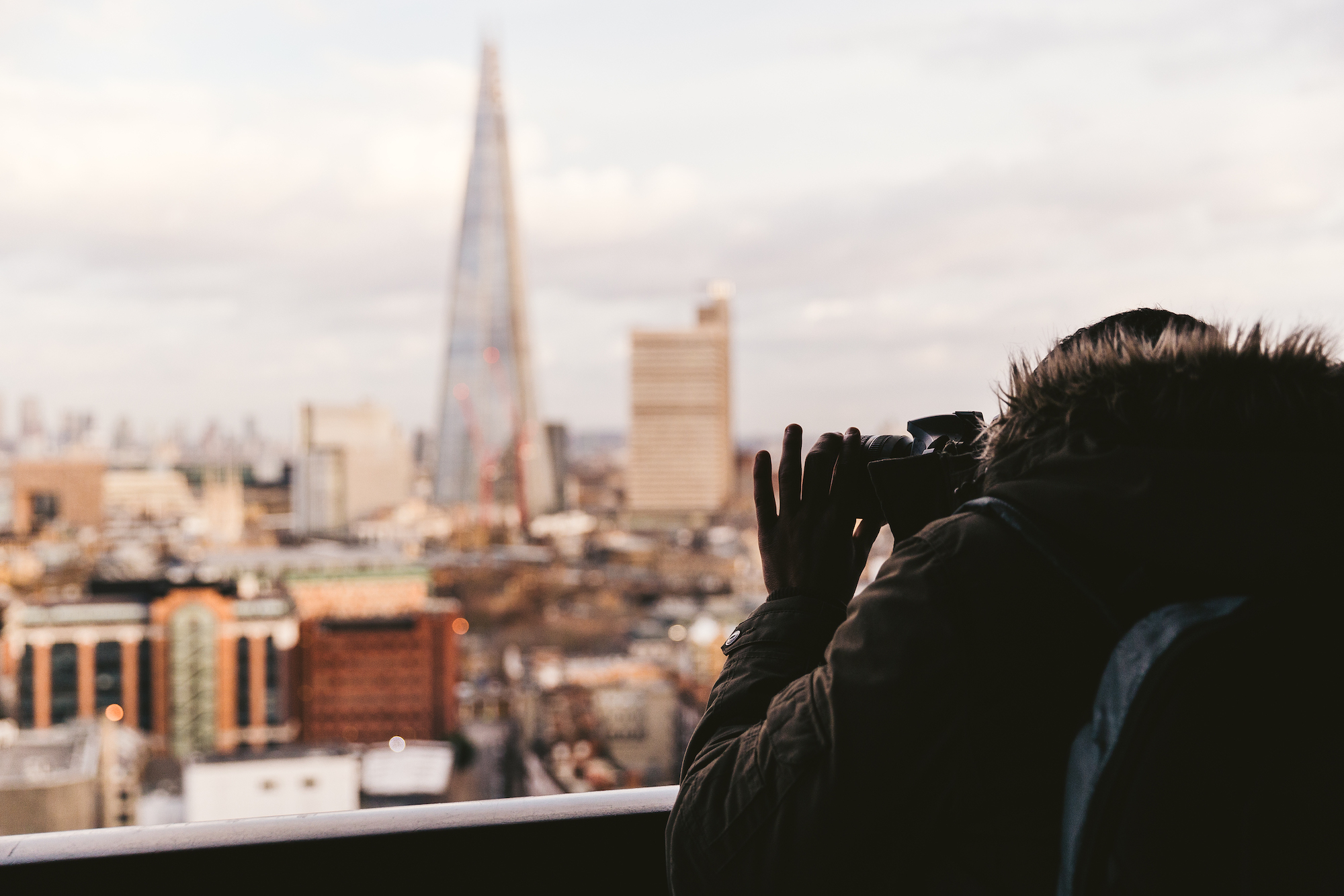 Photographer taking a picture from the viewing deck of the Tate Modern, Londonm
