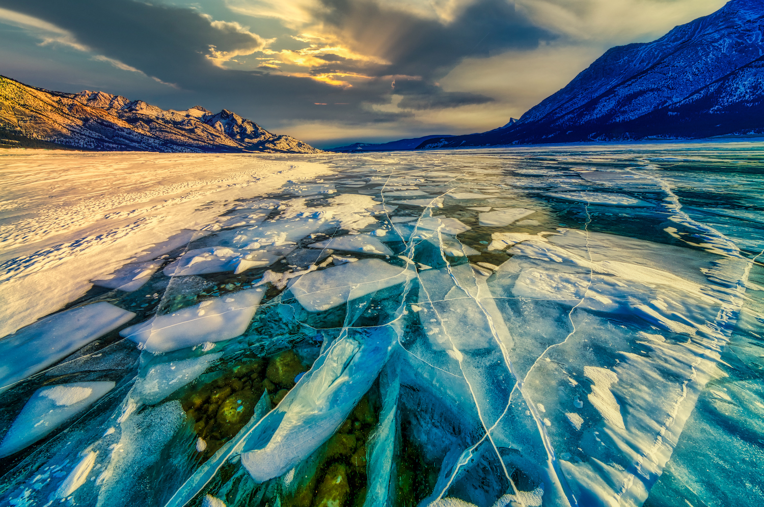 Abraham Lake in the Canadian Rockies of Alberta comes alive in the long and cold winter with staggering beauty.