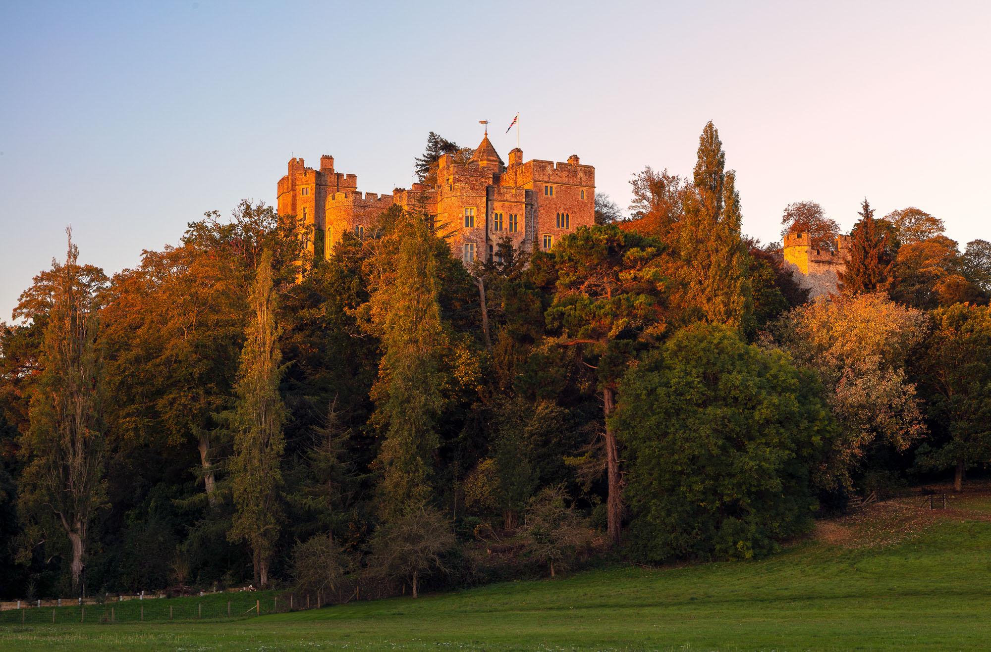 Dunster Castle, England, during the golden hour