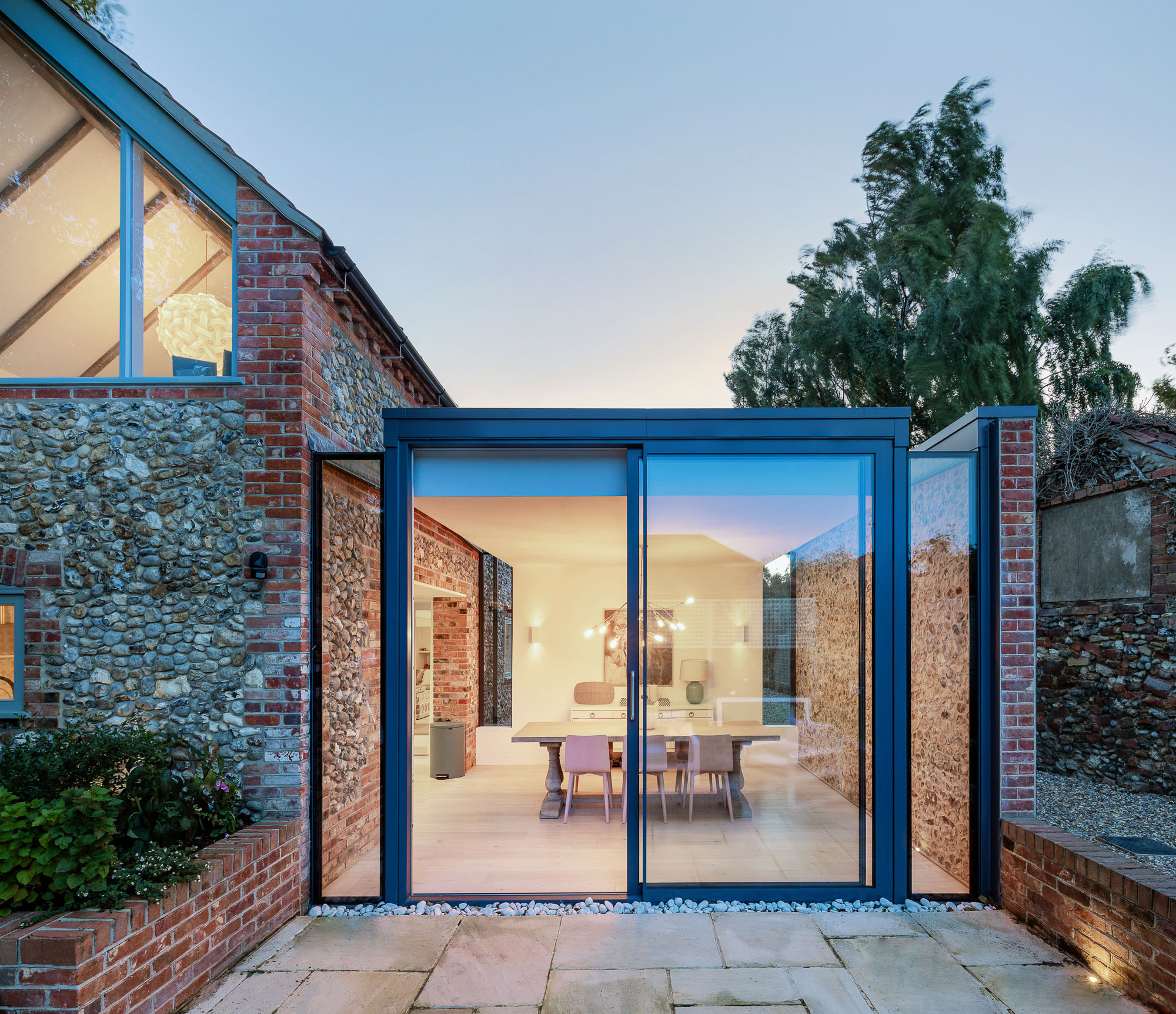 Architectural photography of glass doors leading to a patio captured from a 1-point perspective