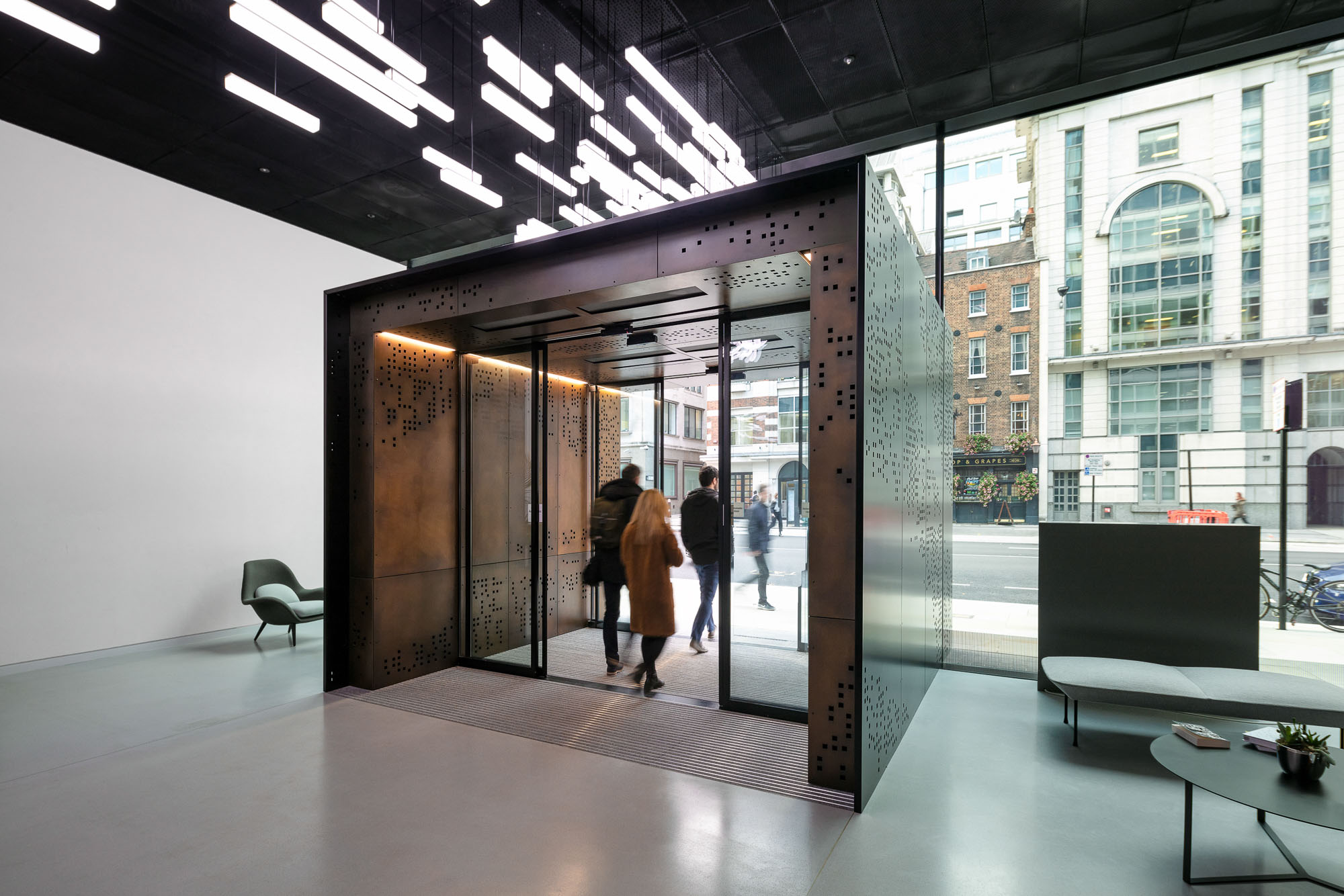Architectural image of an office hallway with glass doors and windows