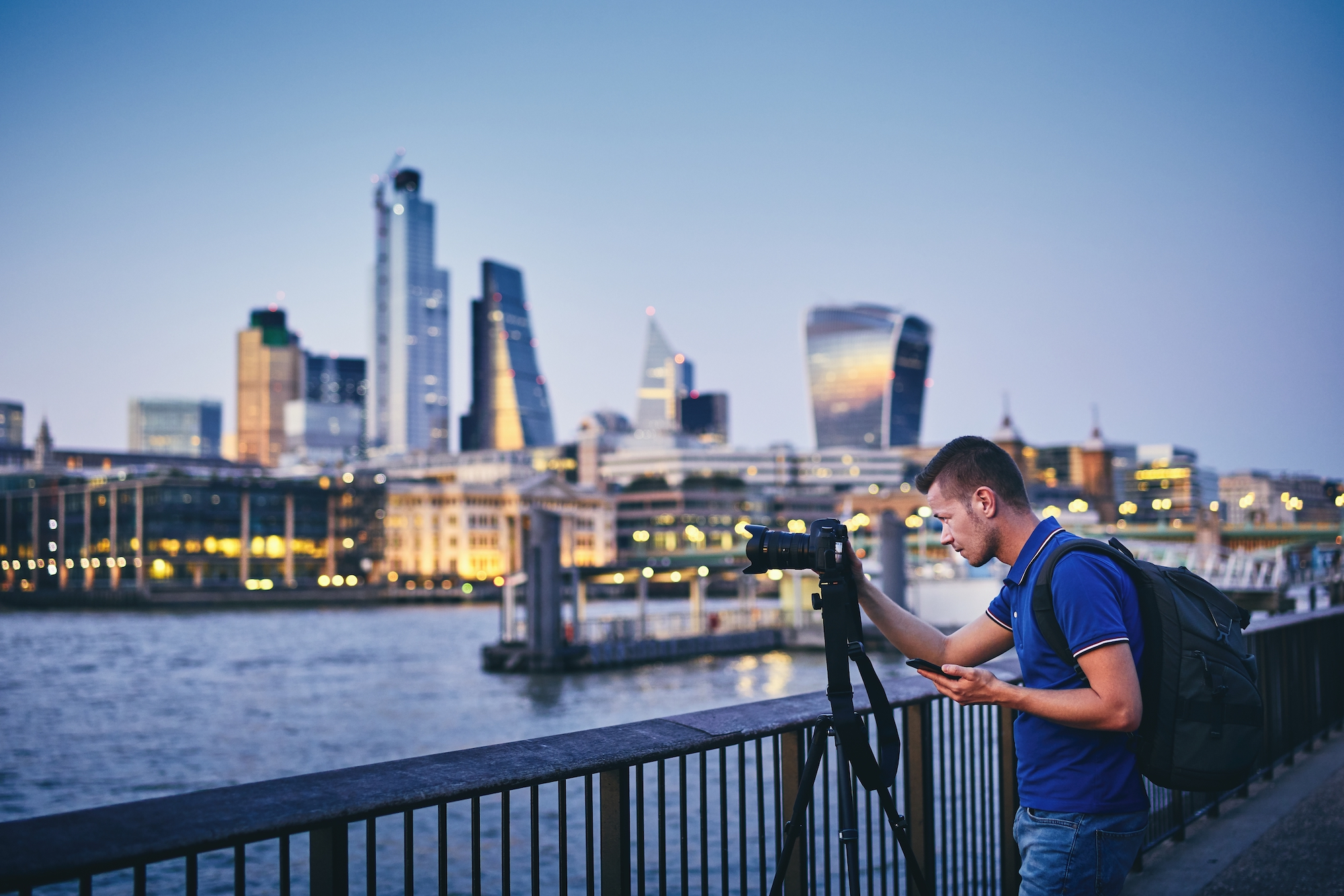 Photographer taking an architectural shot of the City of London skyline