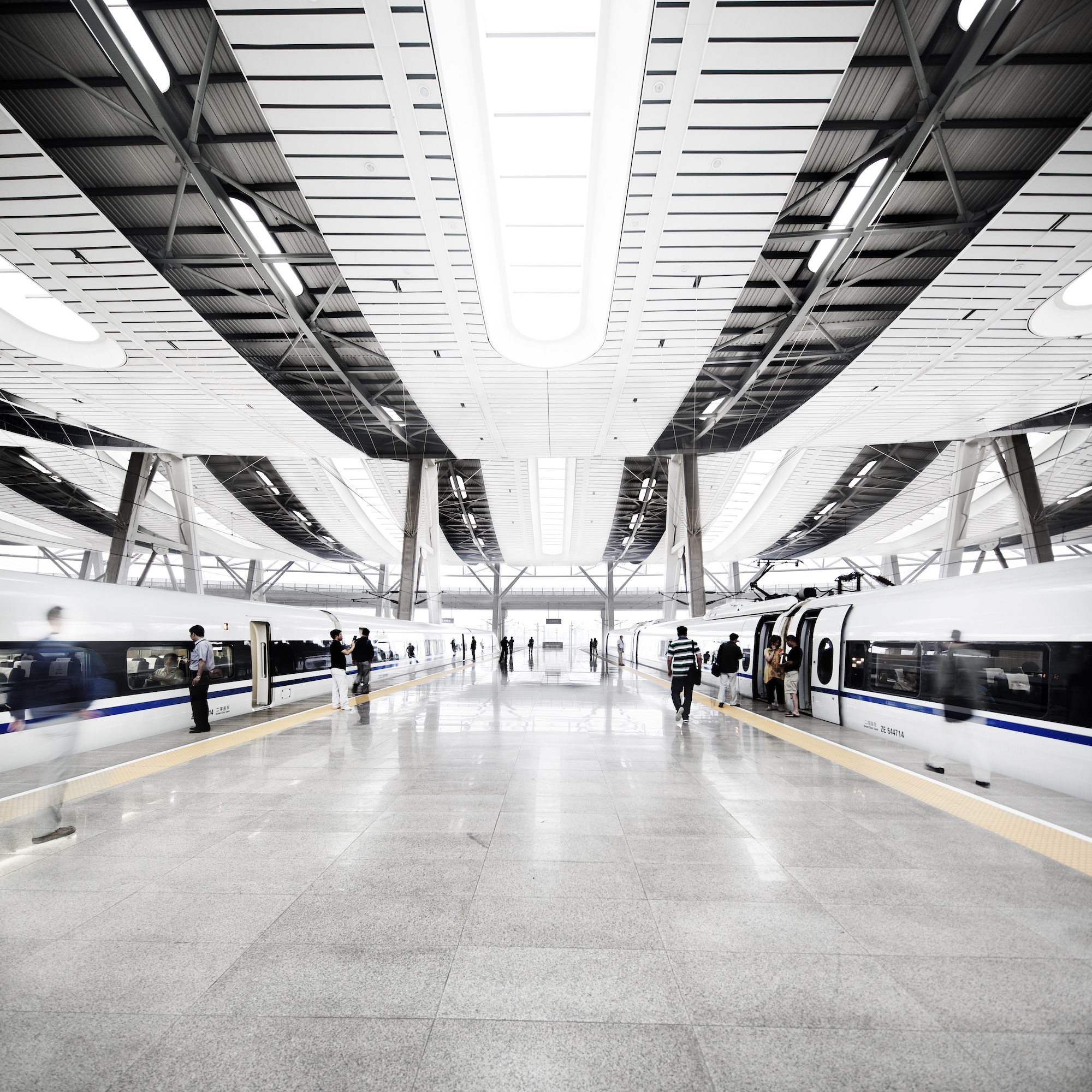 Under the massive curved roof of the Beijing South Railway Station, China