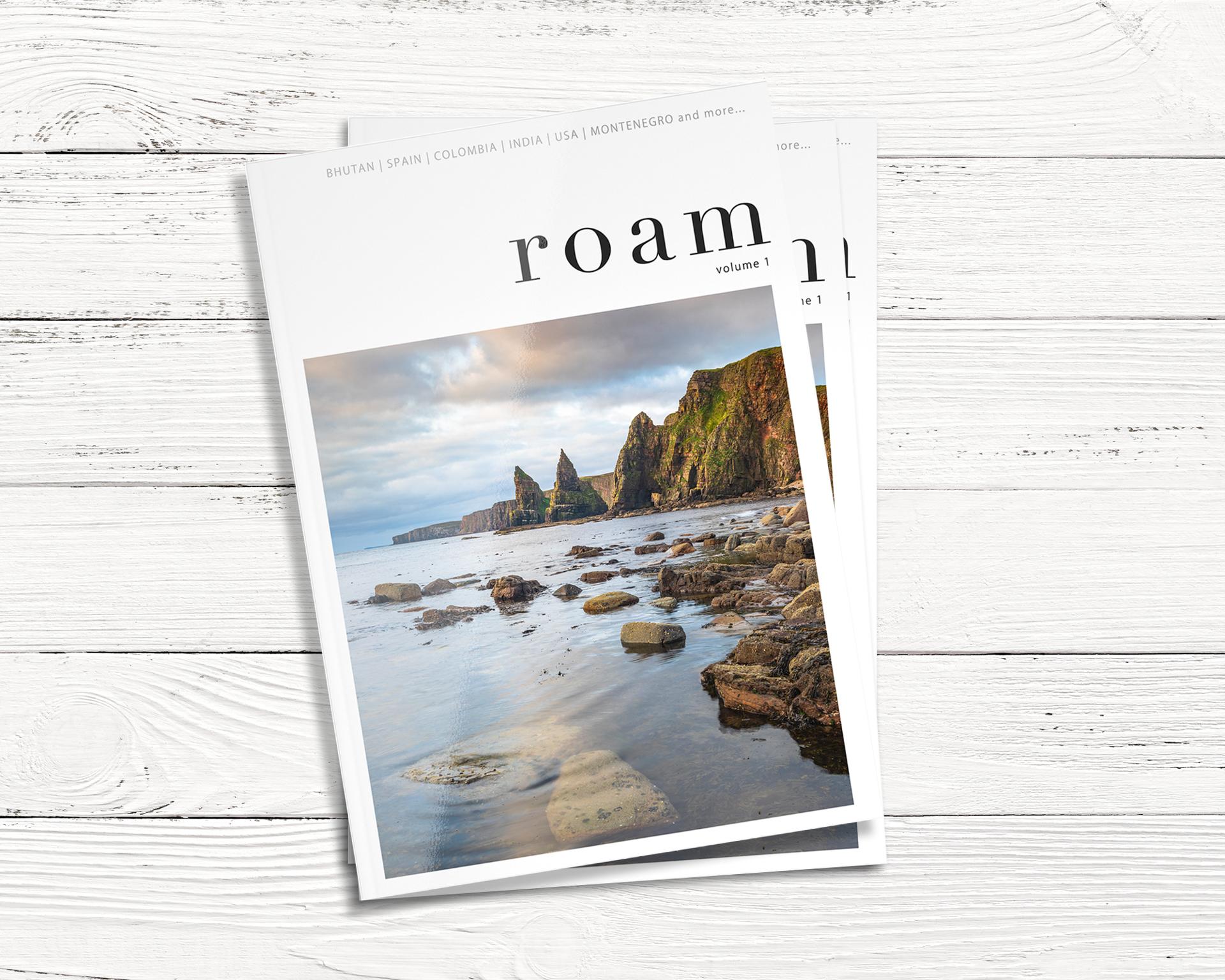 roam travel magazine against a wooden background