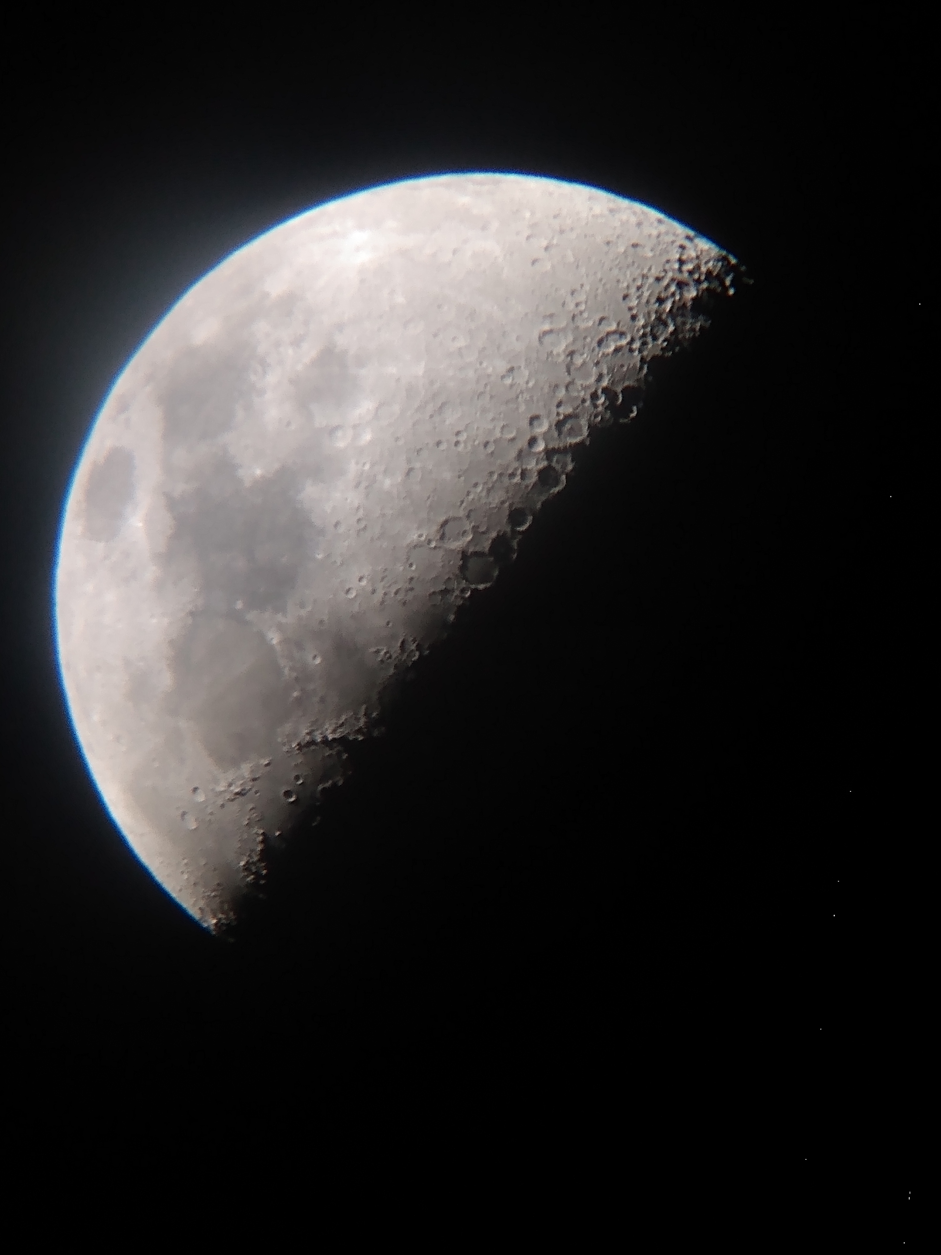 The moon photographed through a telescope known as afocal photography