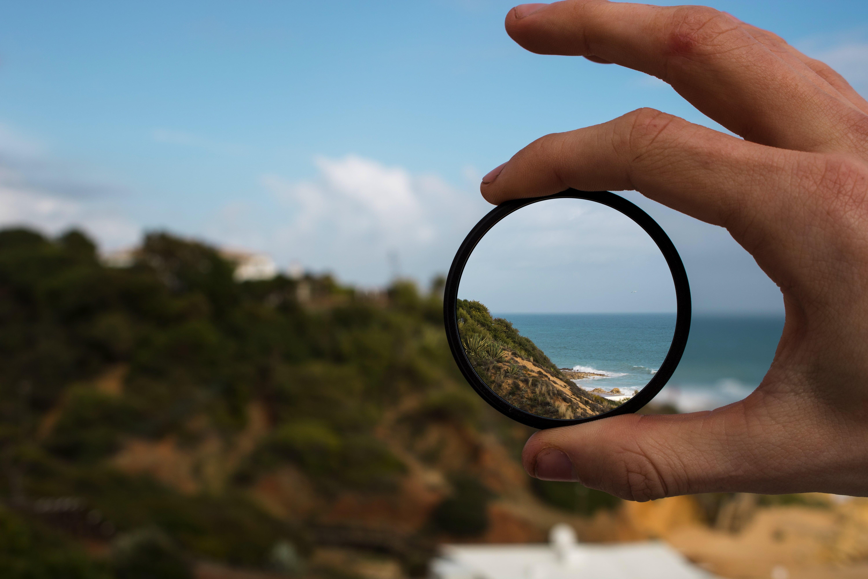 Hand holding a UV camera lens filter