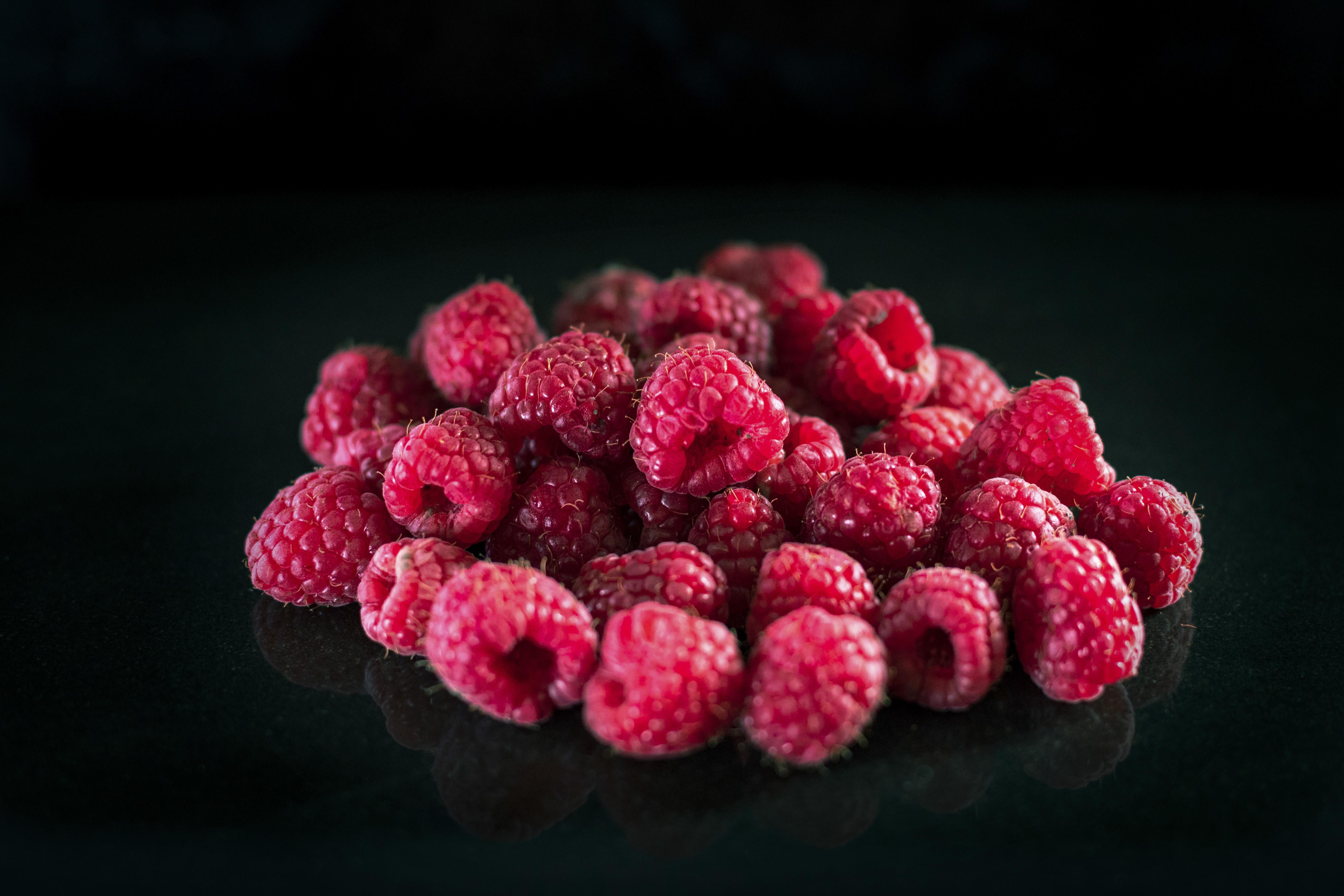 Raspberries against a black background, studio shot