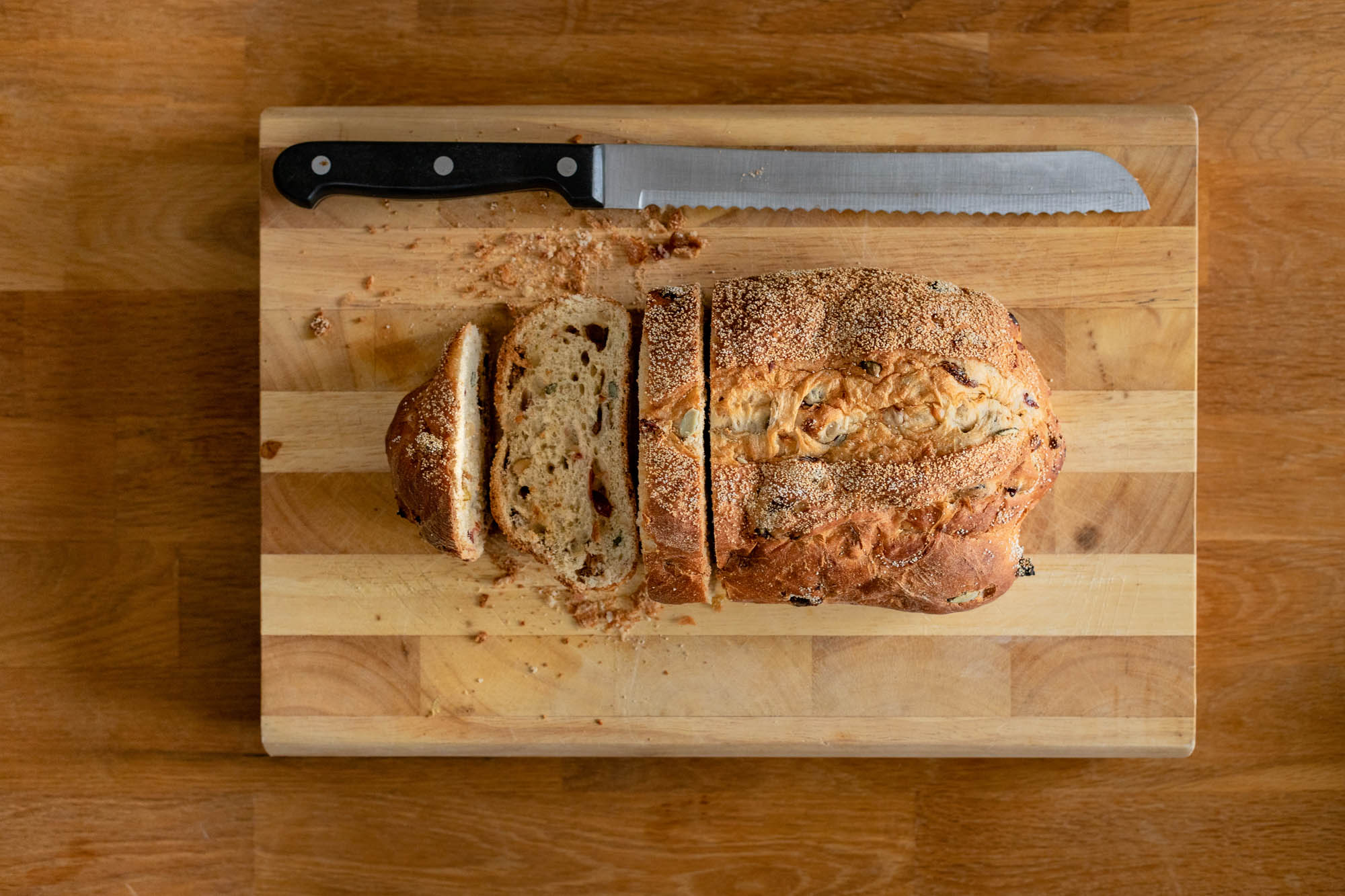 Overhead view of bread on a wooden chopping board