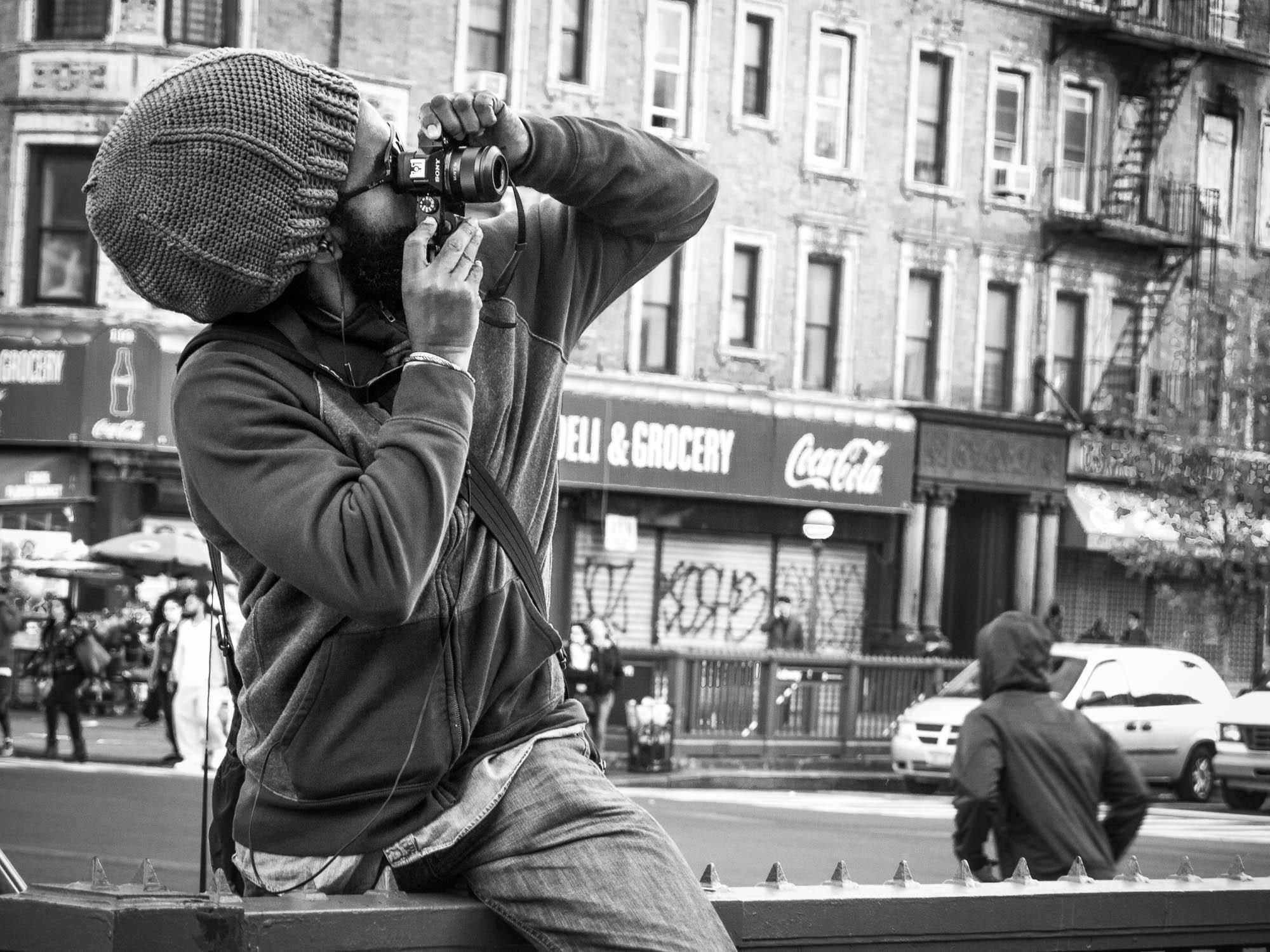 A photographer in Harlem, New York, USA