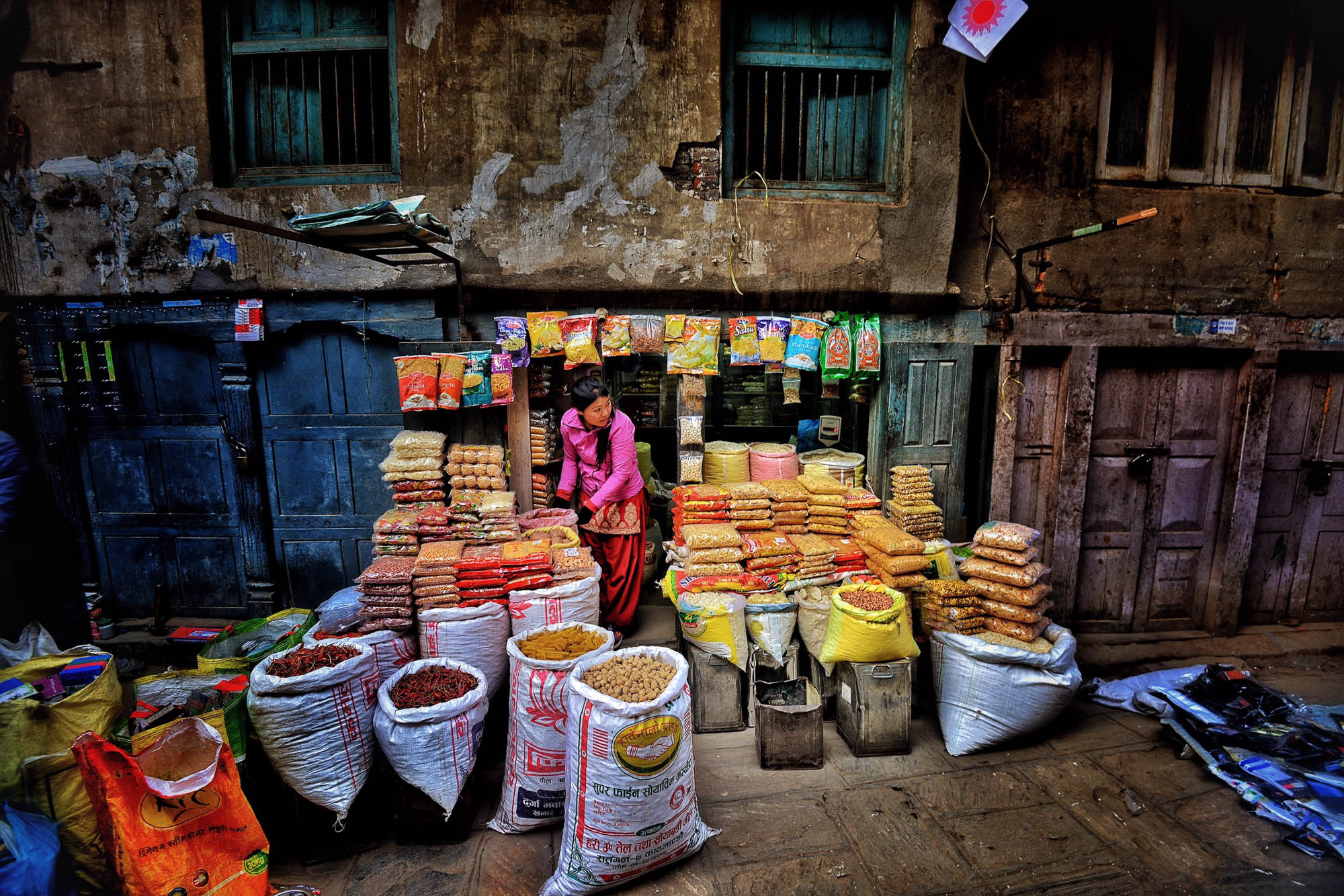 A lady selling beans and spices on the street of Kathmandu, Nepal.