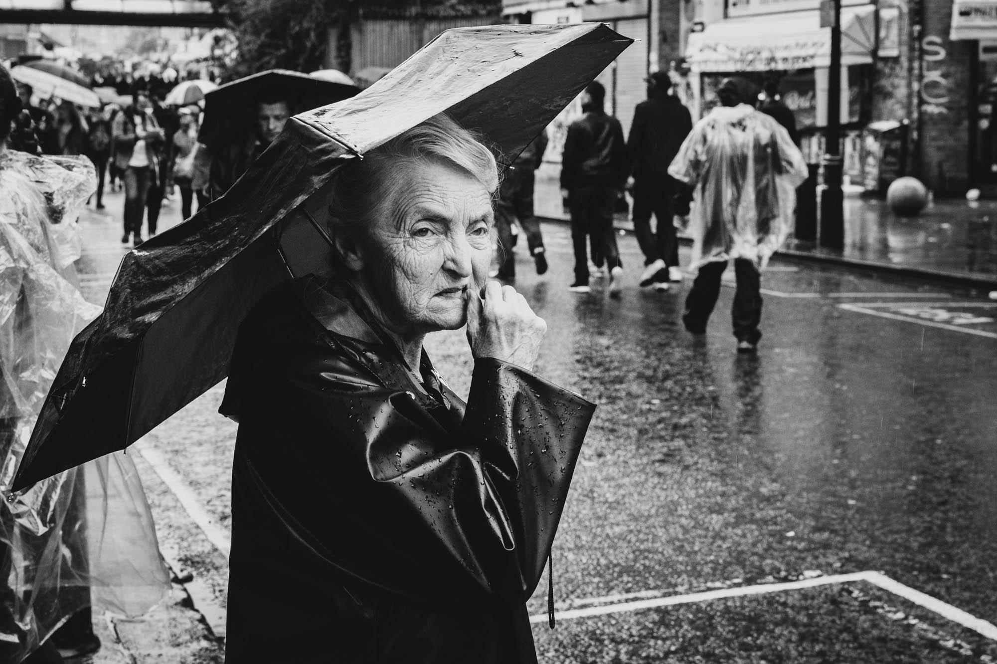 A lady at Portobello Market, London, in black and white