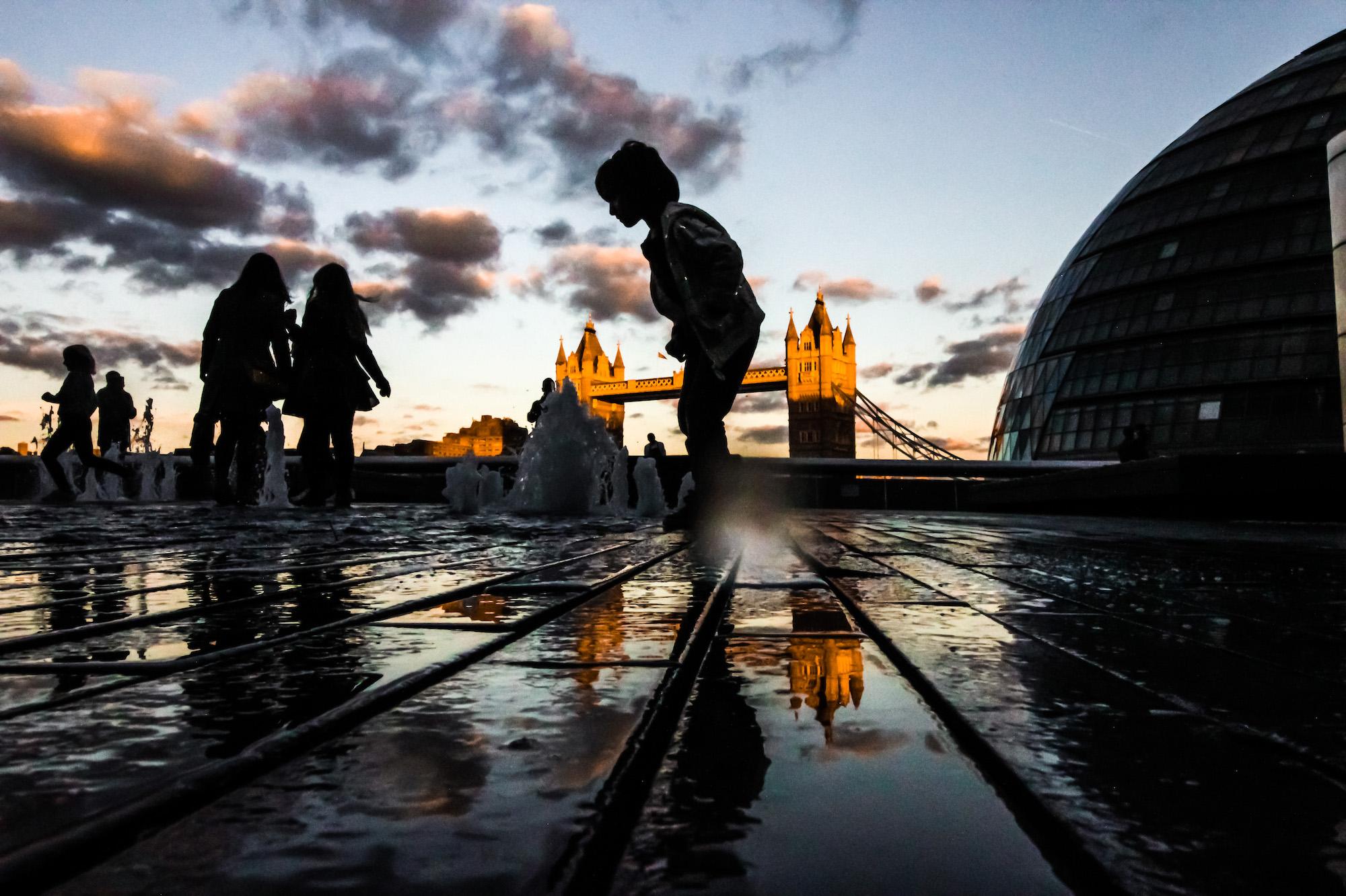 Low camera angle at City Hall and Tower Bridge, London