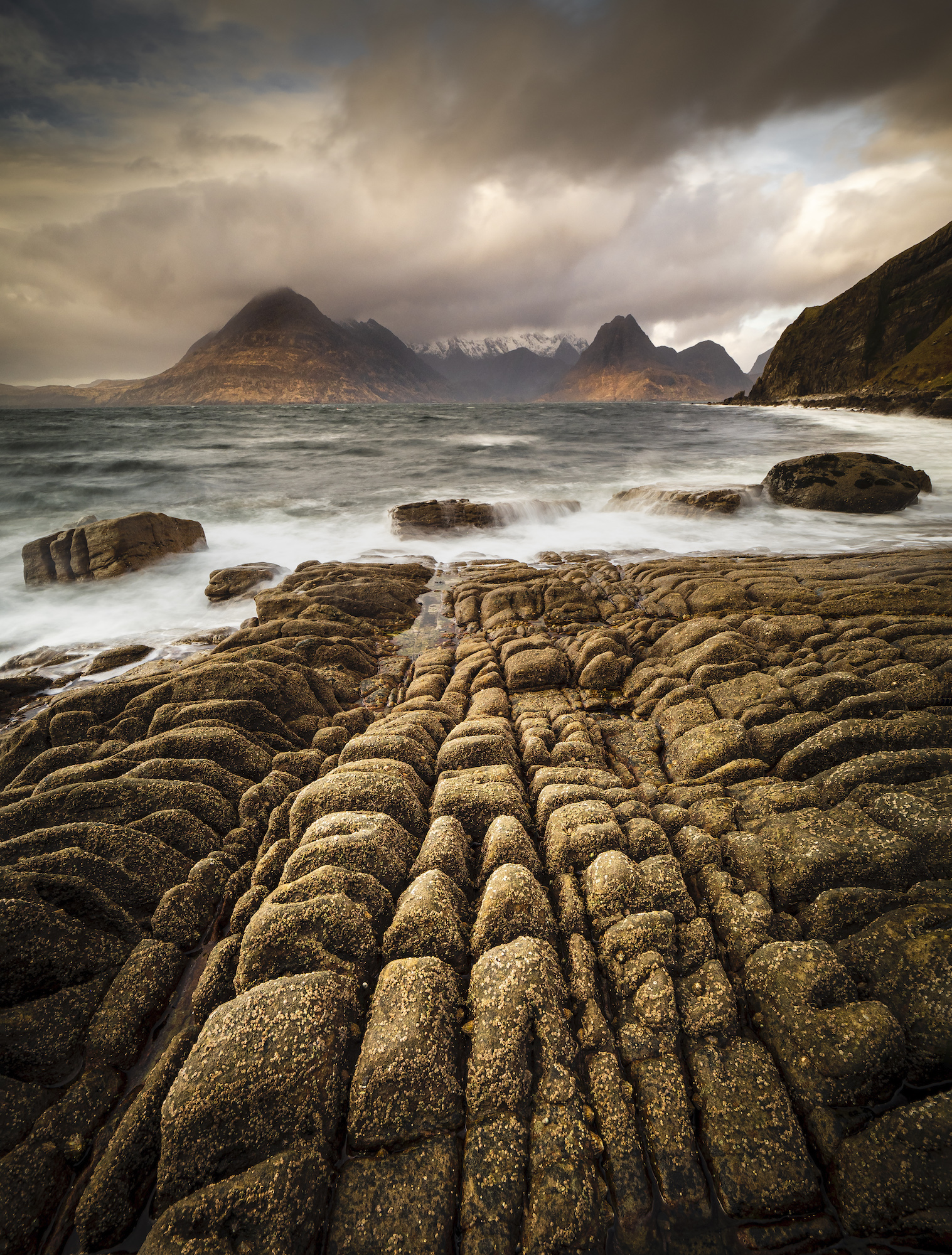 Lines in the rocks at Elgol leading to the Black Cullin mountains across the bay