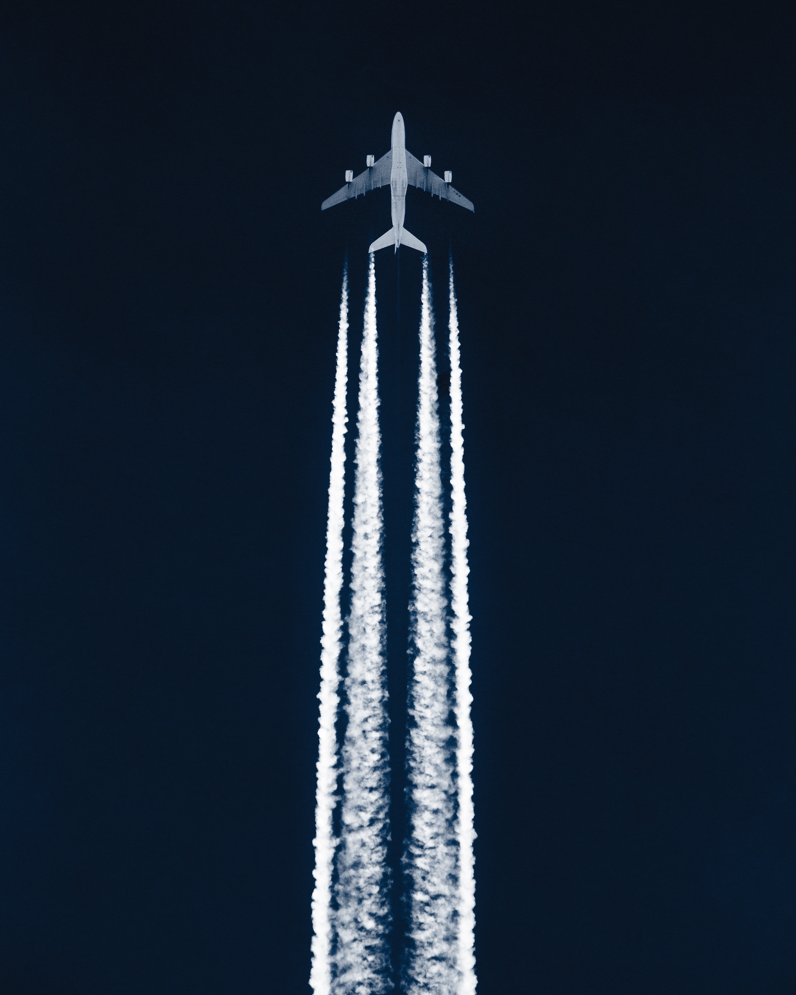 Passenger airplane cruising in the sky leaving contrails behind it