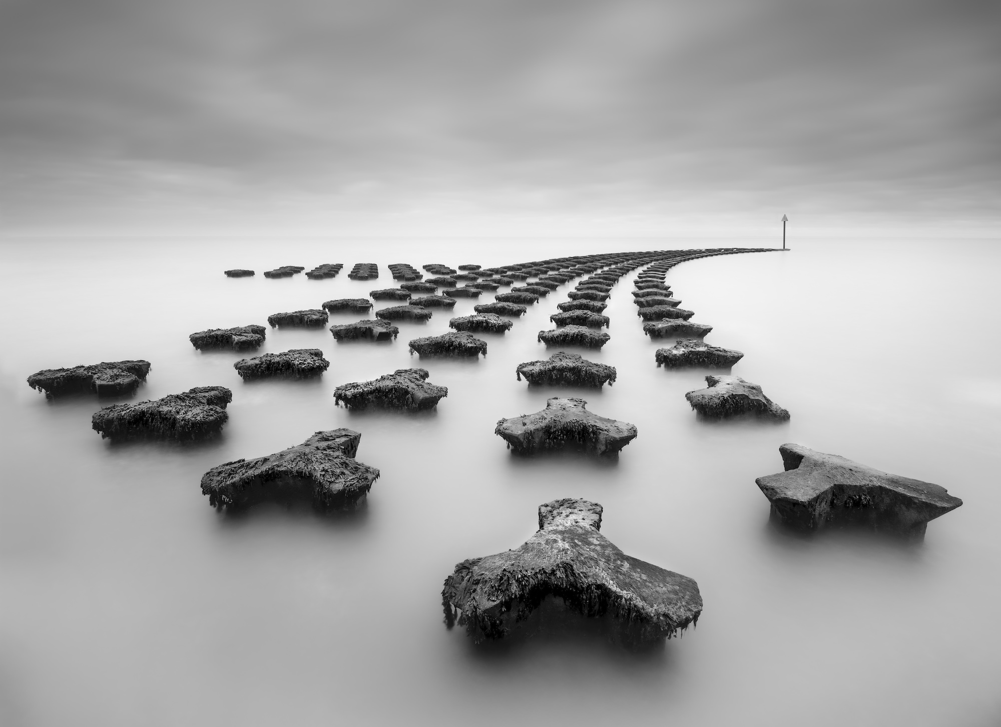 Long exposure image of the curved sea defenses at Felixstowe, England