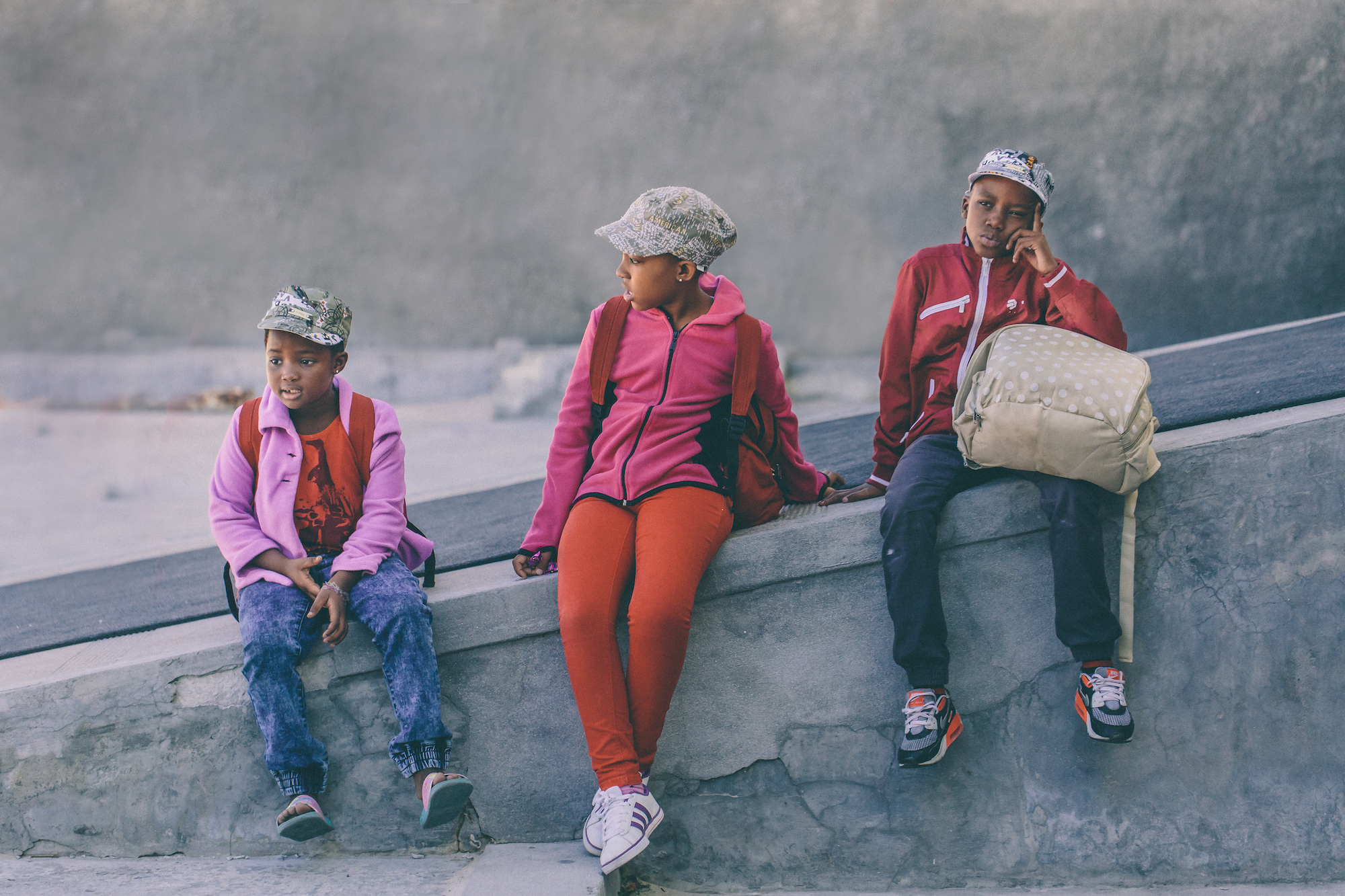 3 kids waiting in Cape Town, South Africa