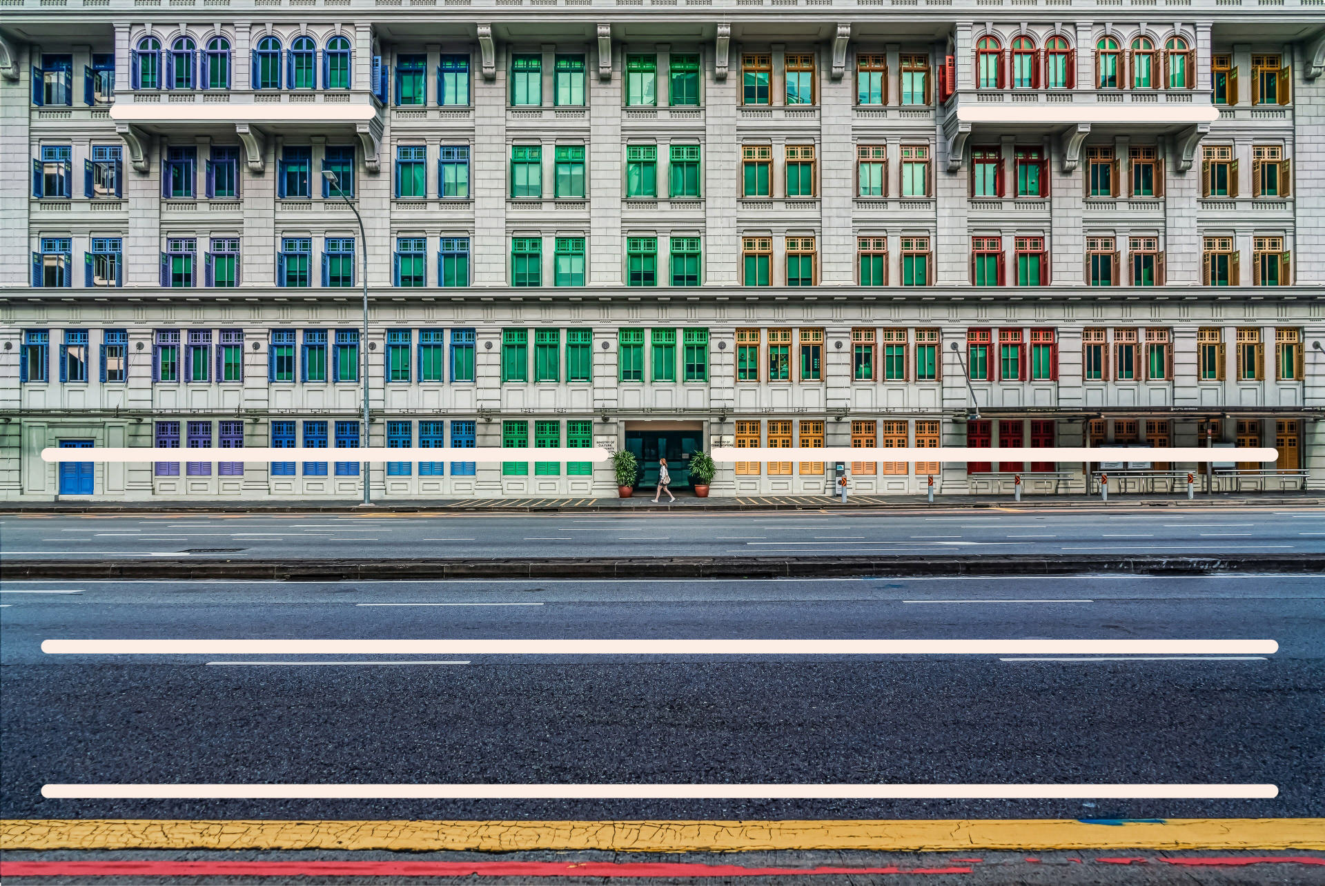 The colourful windows of a building in Singapore with added leading lines to show the compositional technique