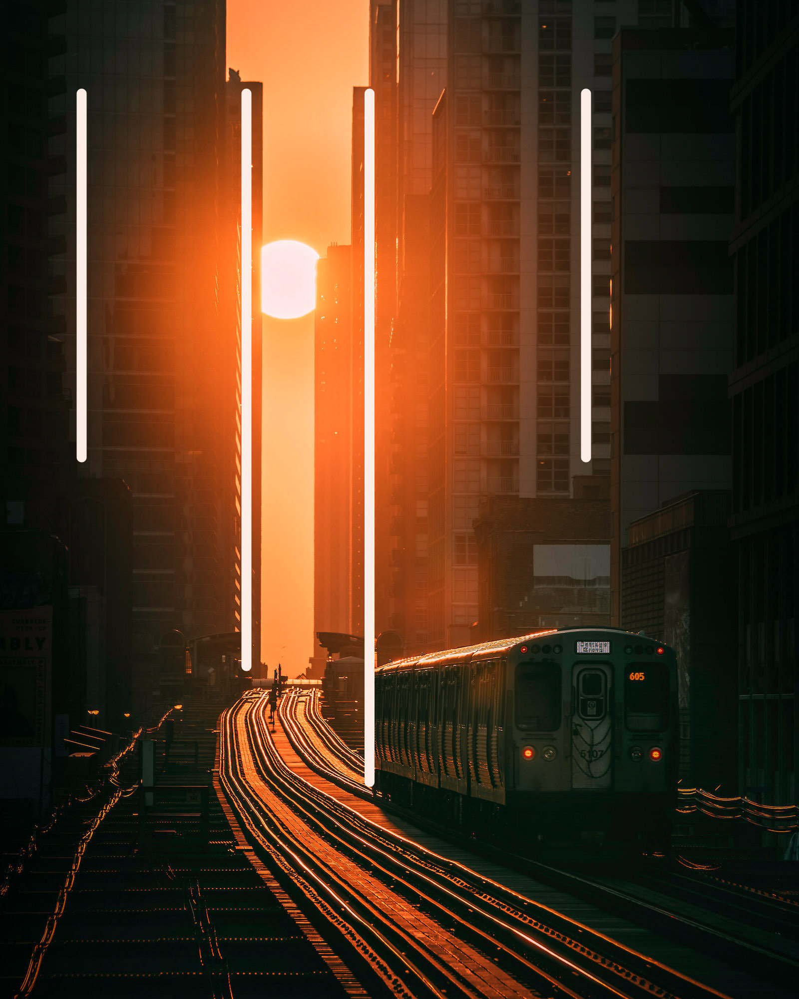 A train makes its way between towering buildings in the golden light of the sun, Chicago USA, with added leading lines to show the compositional technique