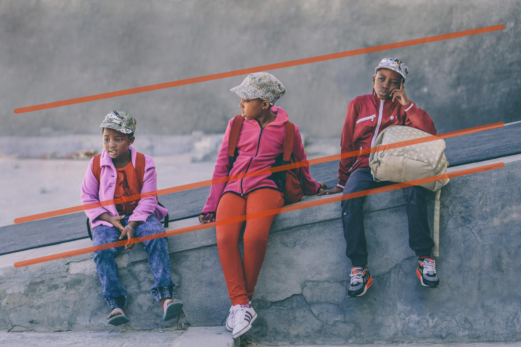 3 kids waiting in Cape Town, South Africa with added leading lines showing compositional techniqueo