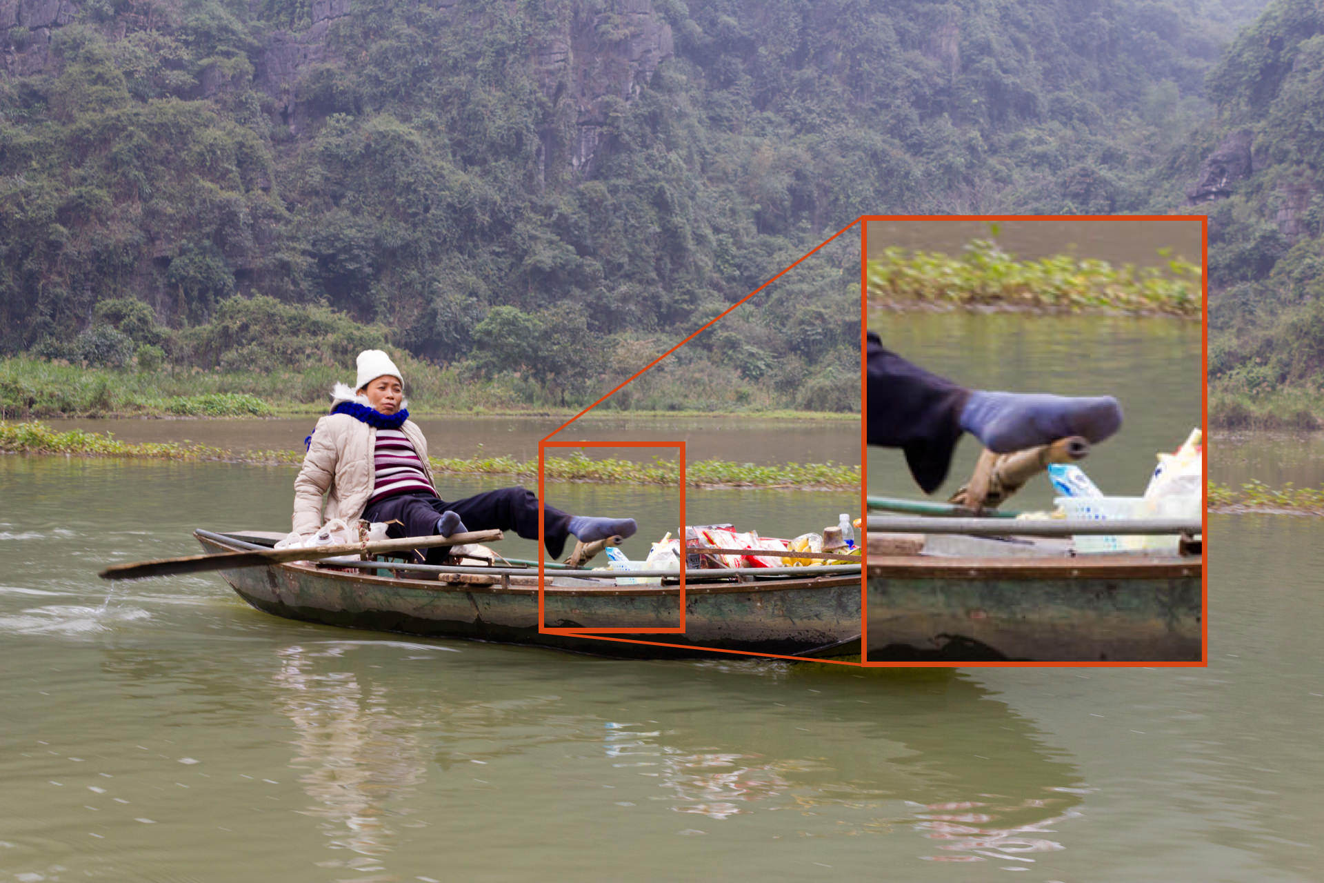 A blurred photo of a person in a boat, caused by a shutter speed too slow to capture the image