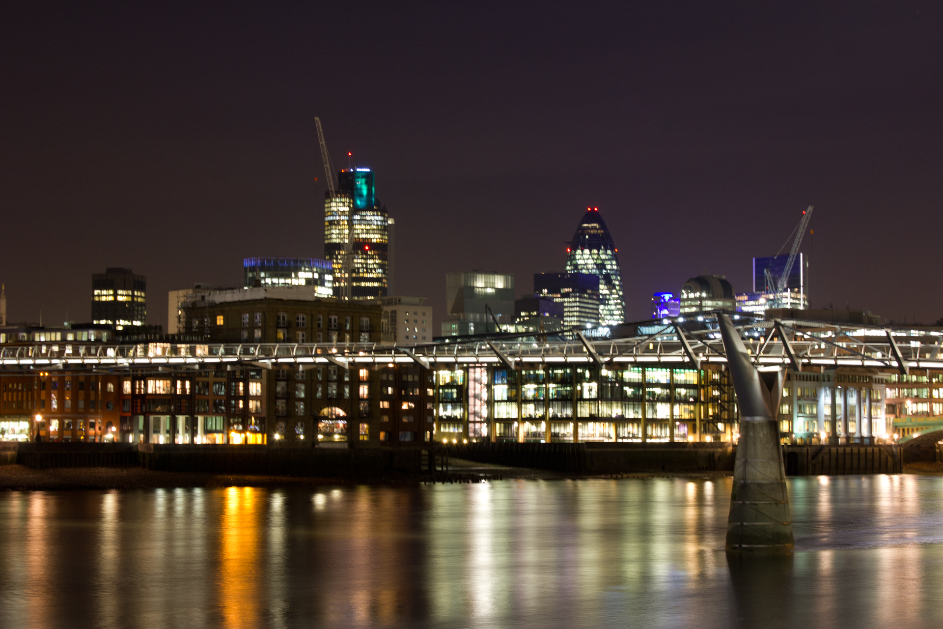 The London skyline at night blurred due to camera shake caused by pressing the shutter