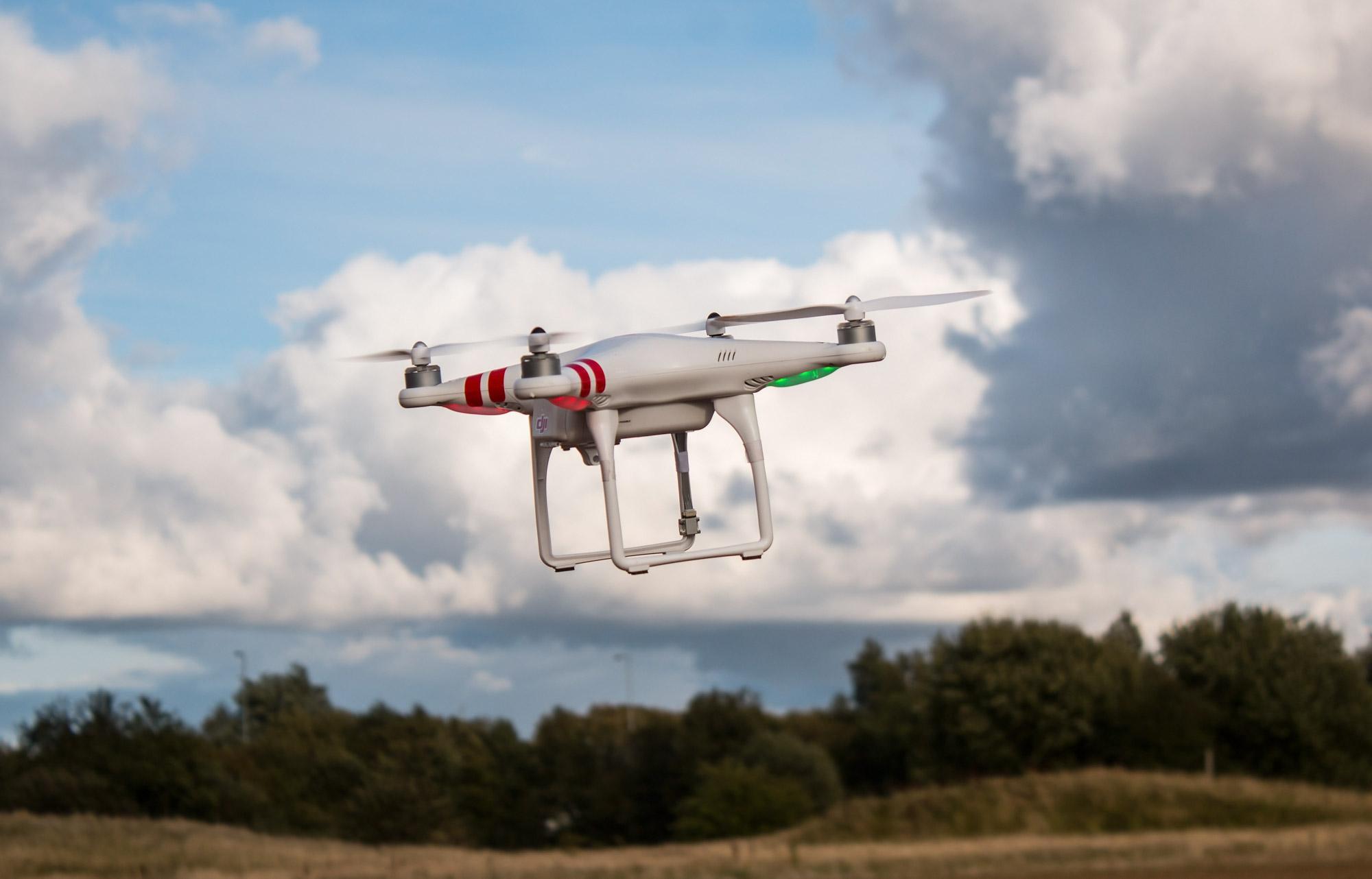 Dji Phantom drone quadcopter in flight