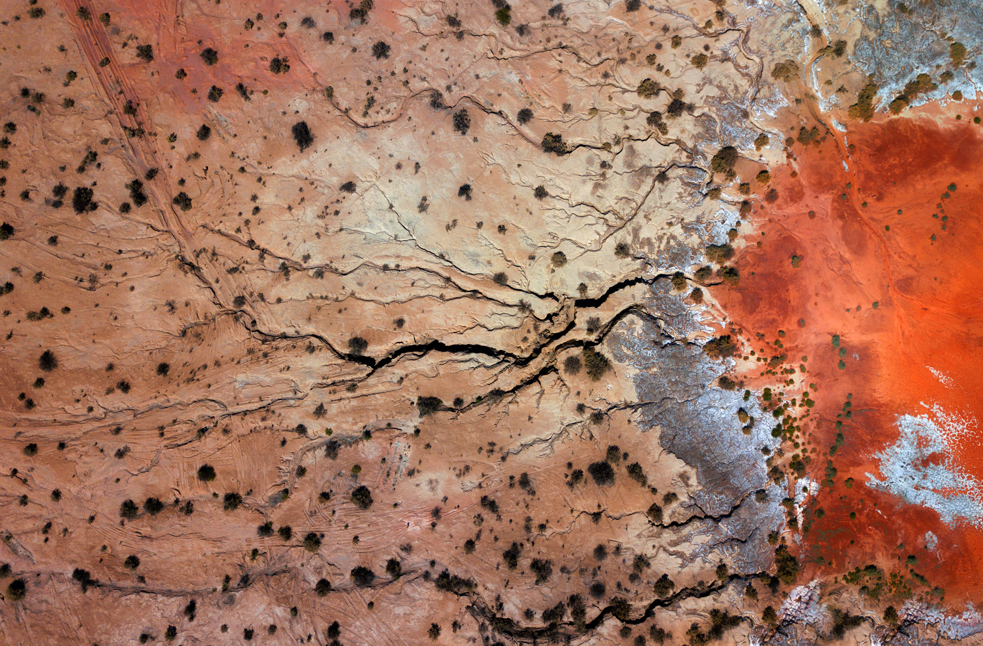 A disused tailings dam in Western Australia's Goldfields looks like a wound on the landscape when photographed from above