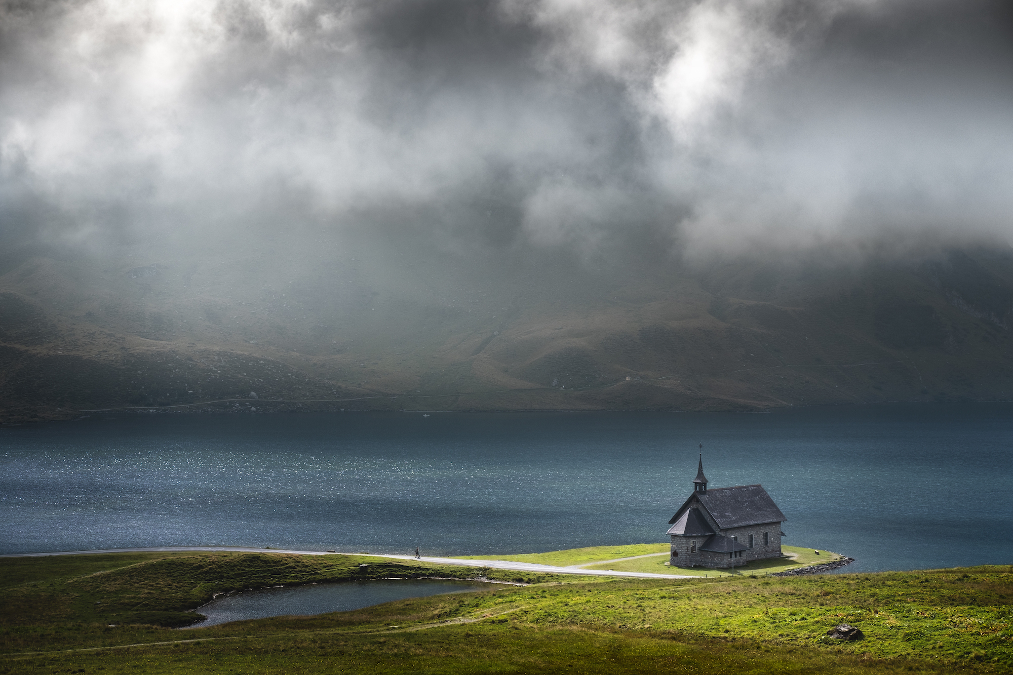 A patch of light illuminating the church at the lake, Switzerland