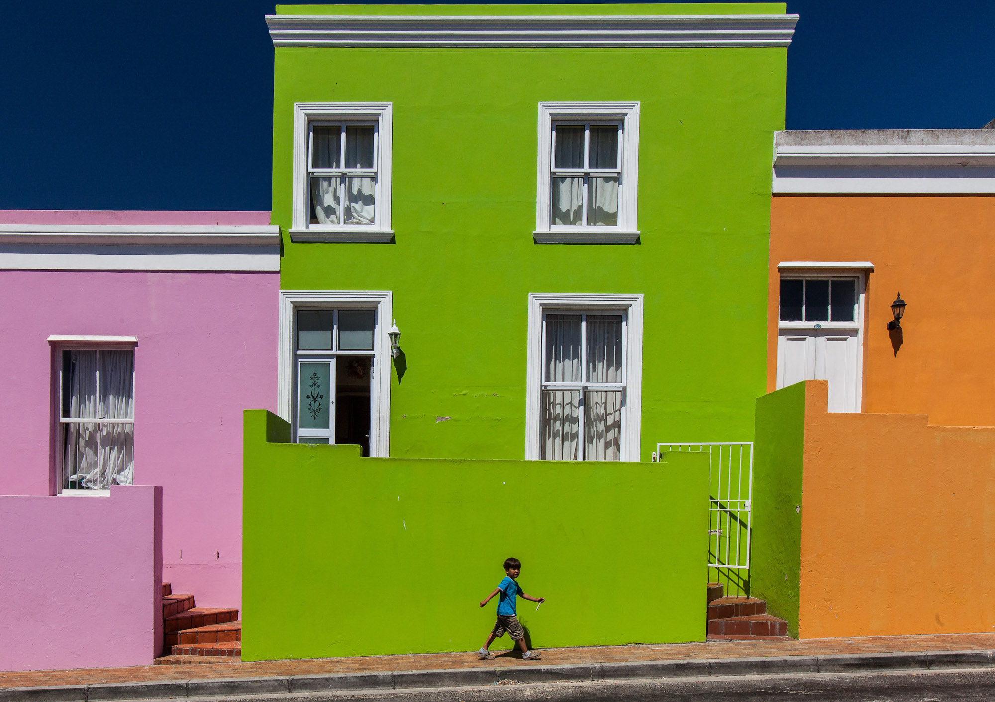 Colourful buildings against a blue sky in Cape Town South Africa
