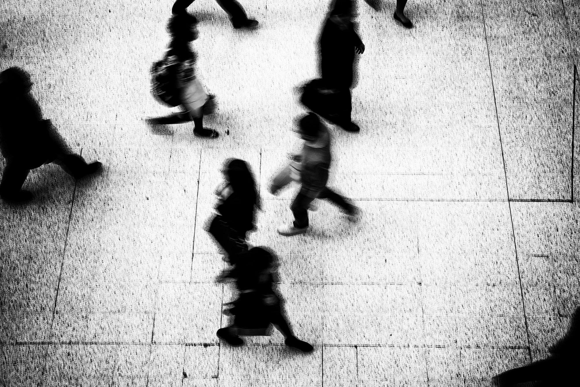 Grainy image of people walking