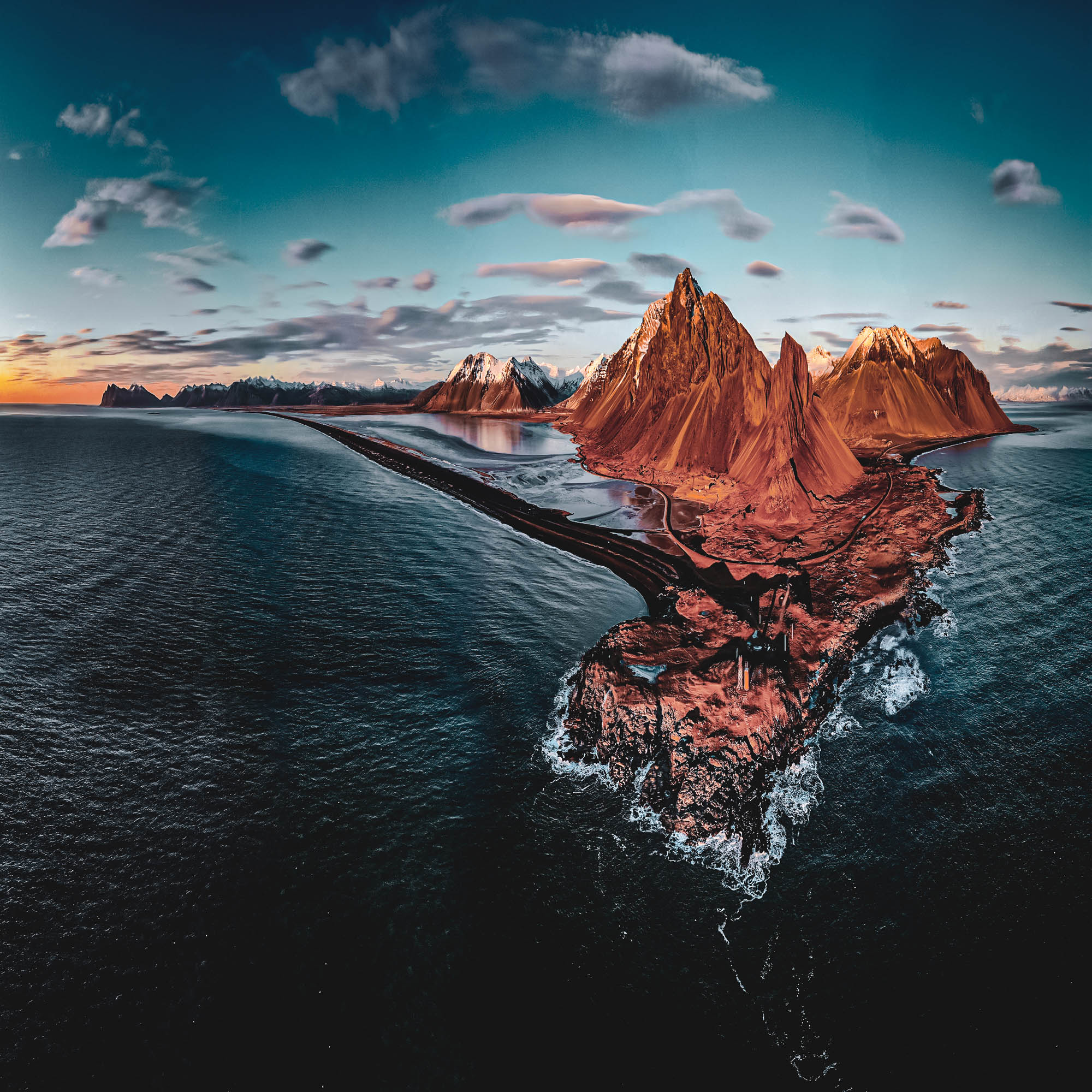 Drone narrowed panorama shot of the East Iceland coast during low winter sun
