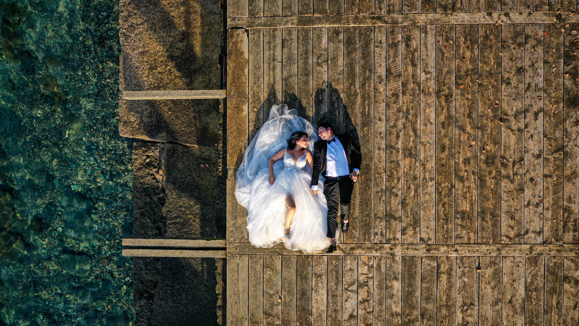 Photo of a bride and groom taken from above by drone