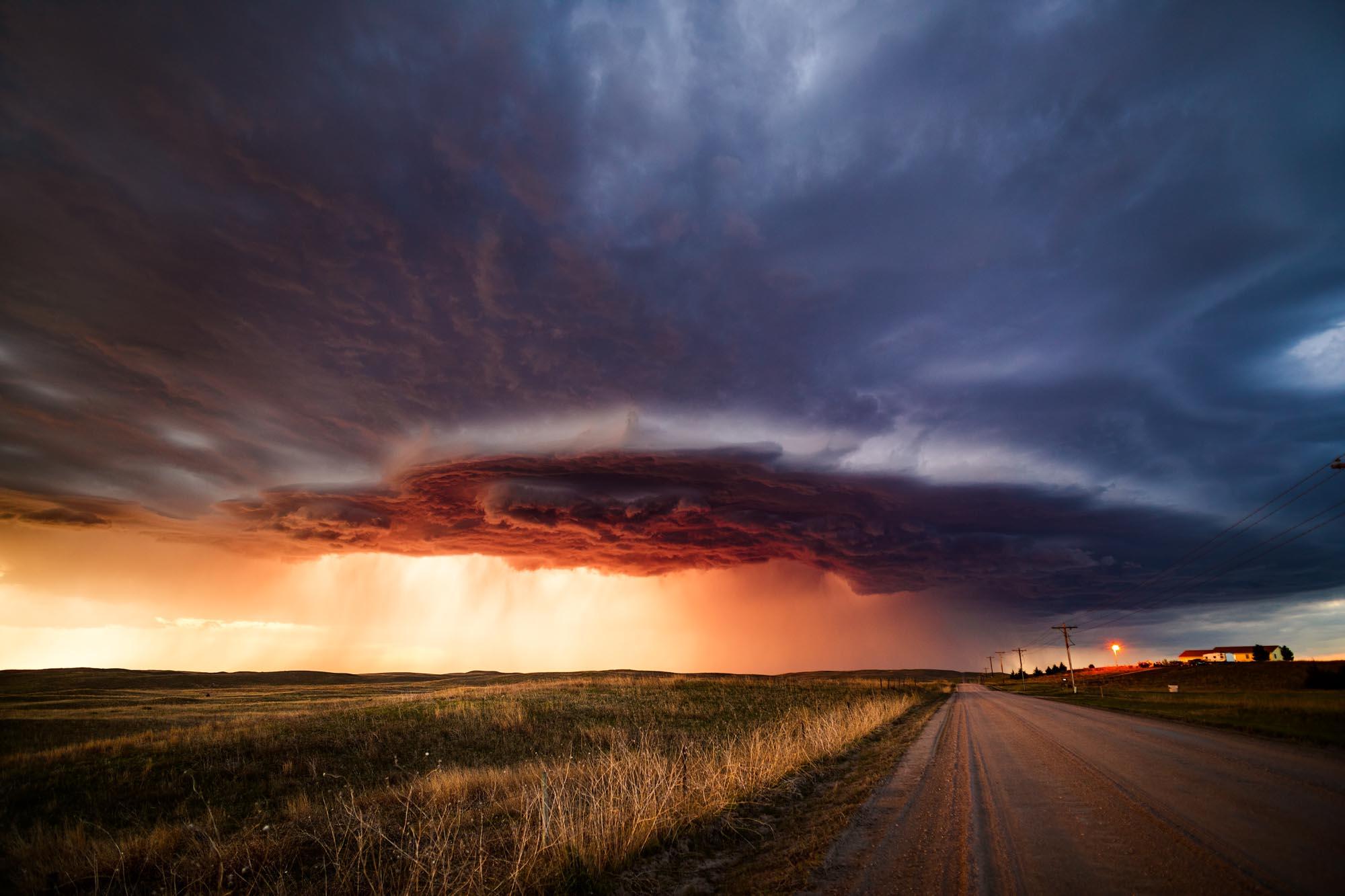 A powerful supercell thunderstorm at sunset spins across the sand hills near North Platte, Nebraska