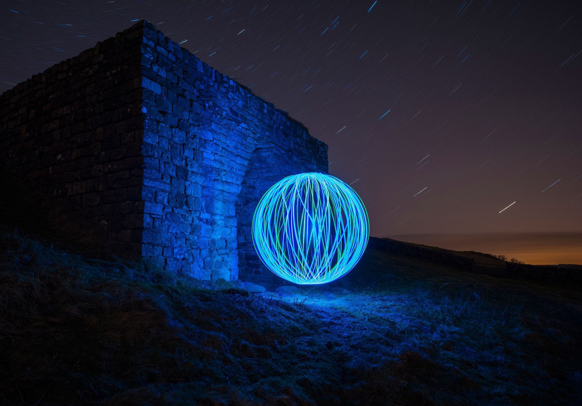 Light orb painting night photography at Hadrian's Wall, Northumberland, England
