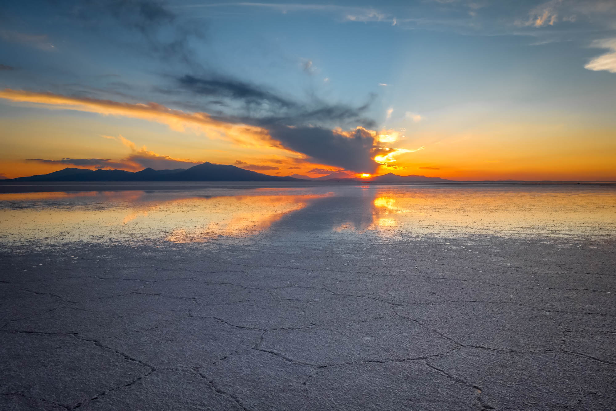 Sunset in Salar de Uyuni salt flats desert, Andes Altiplano, Bolivia